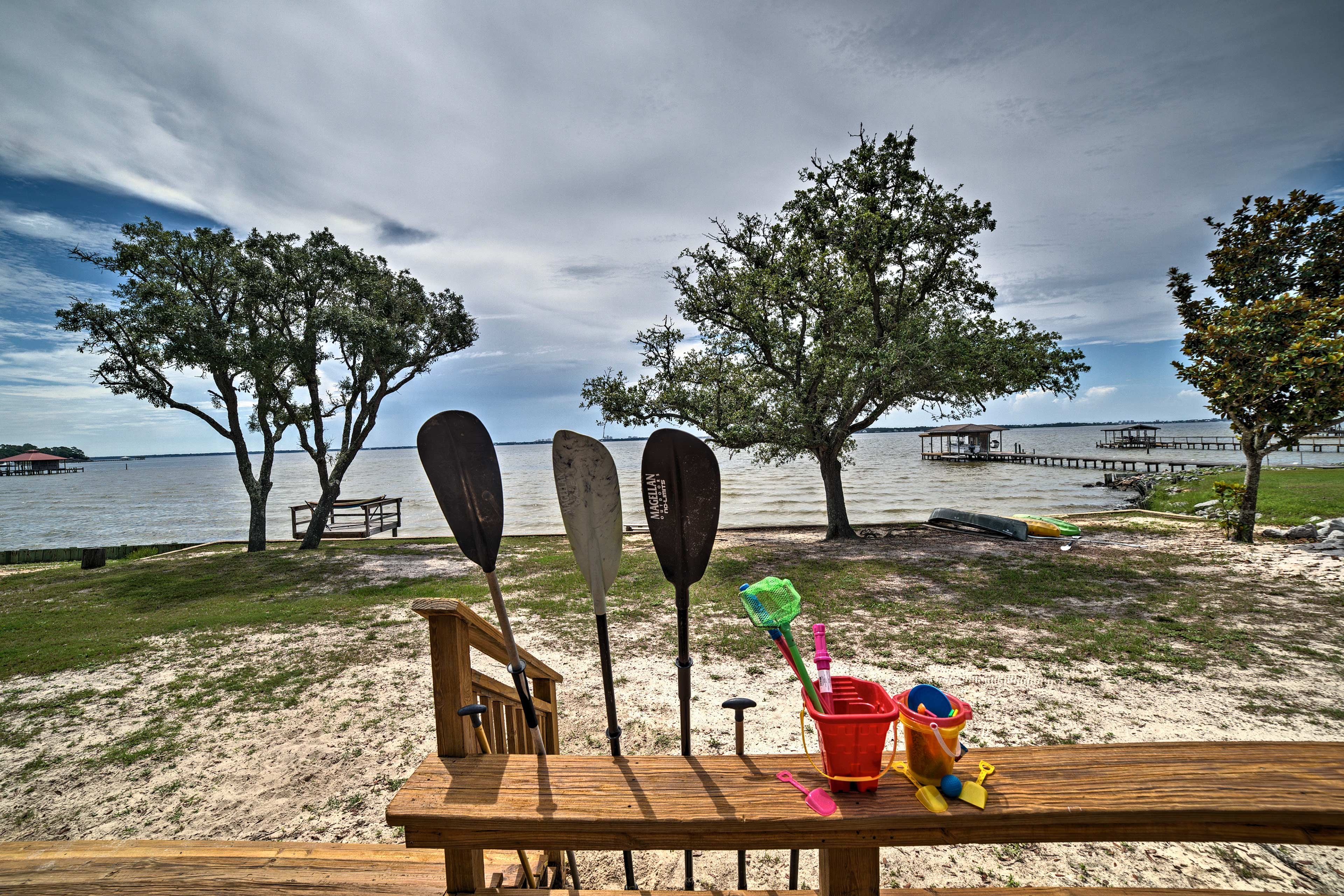 This beach house sleeps 14 and boasts 2 canoes, kayaks, and more.