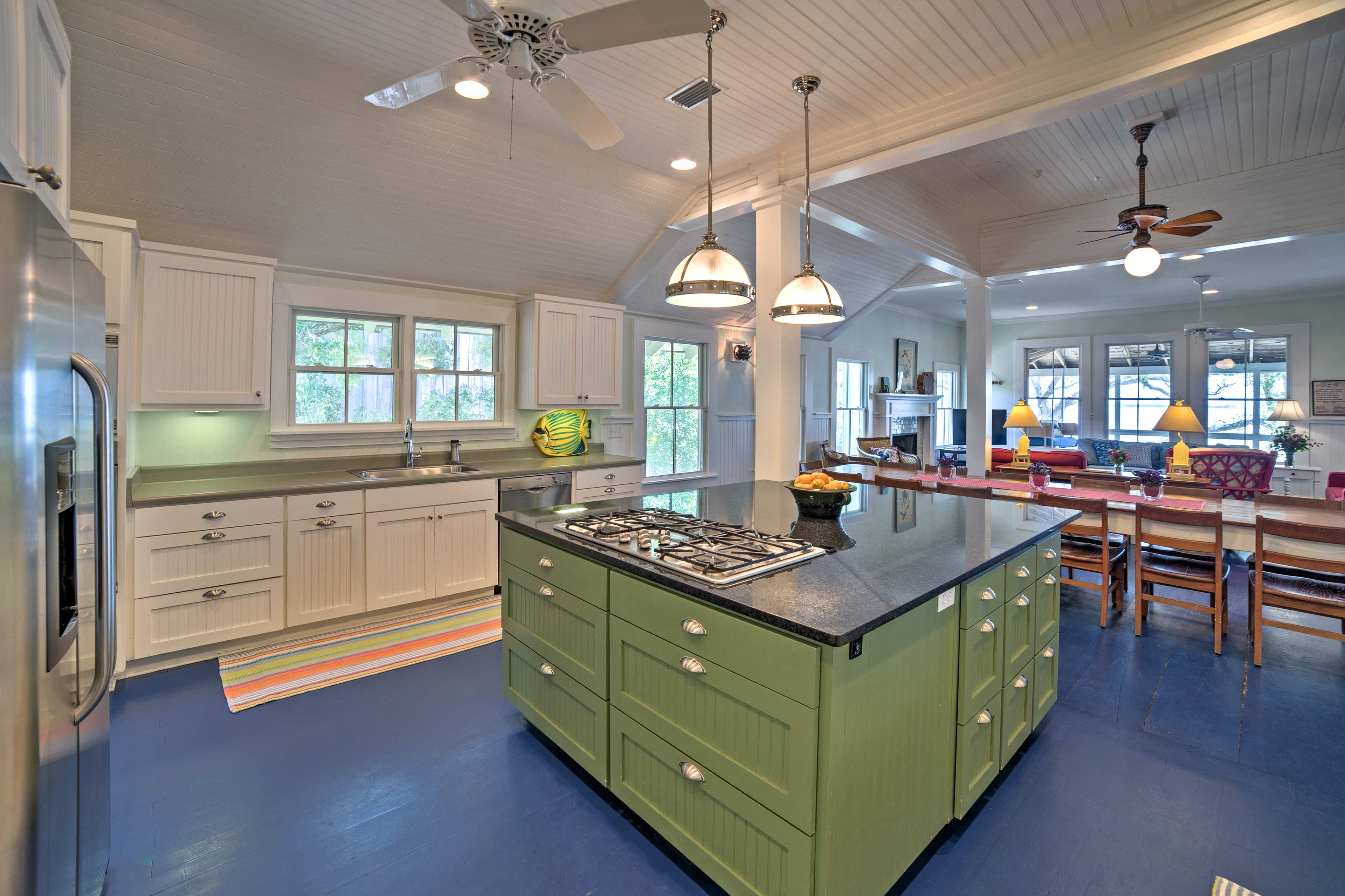 The kitchen space includes stainless steel appliances and an island counter.
