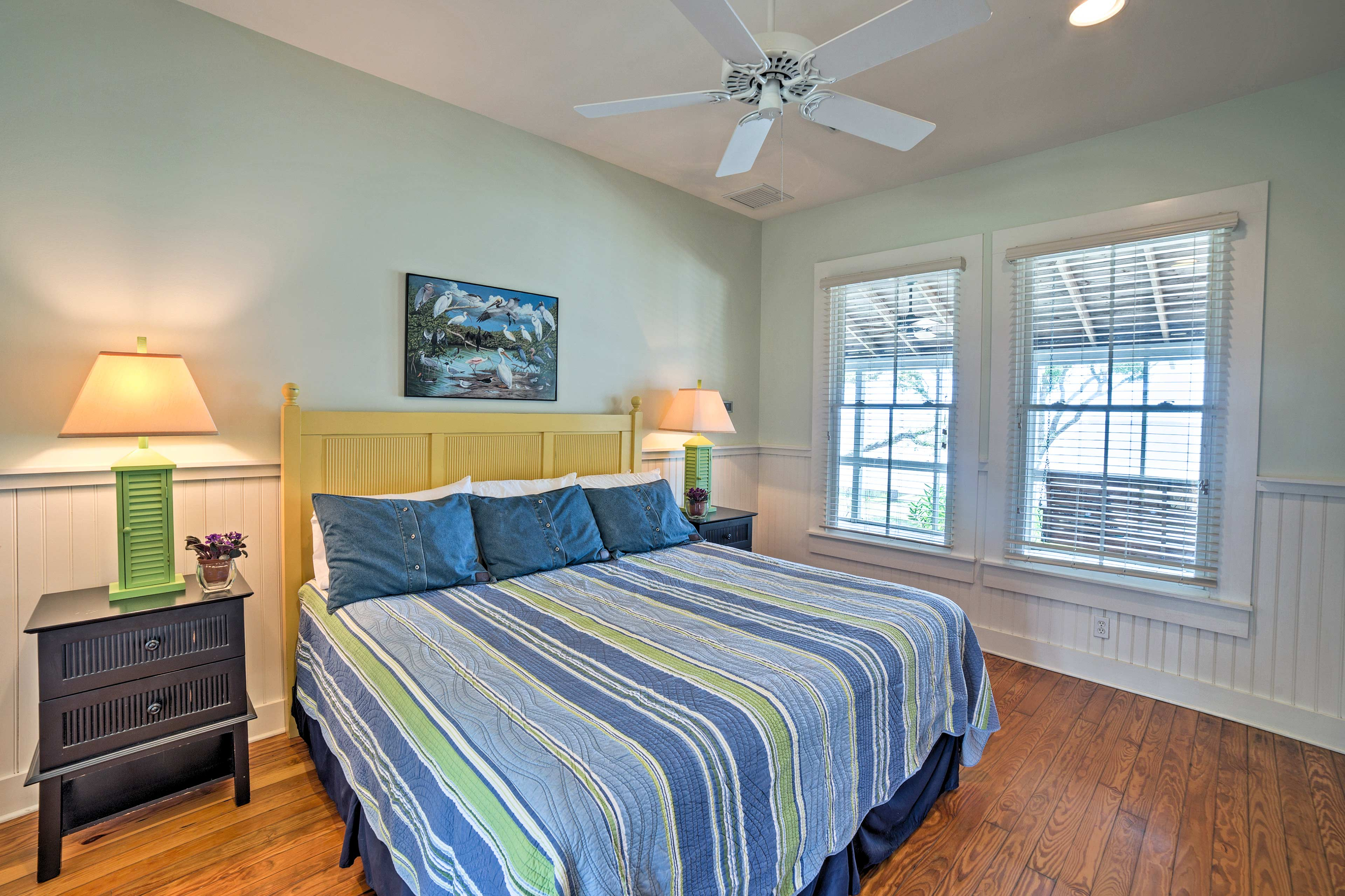 Each bedroom provides access to the screened porch to wake up with bay views.