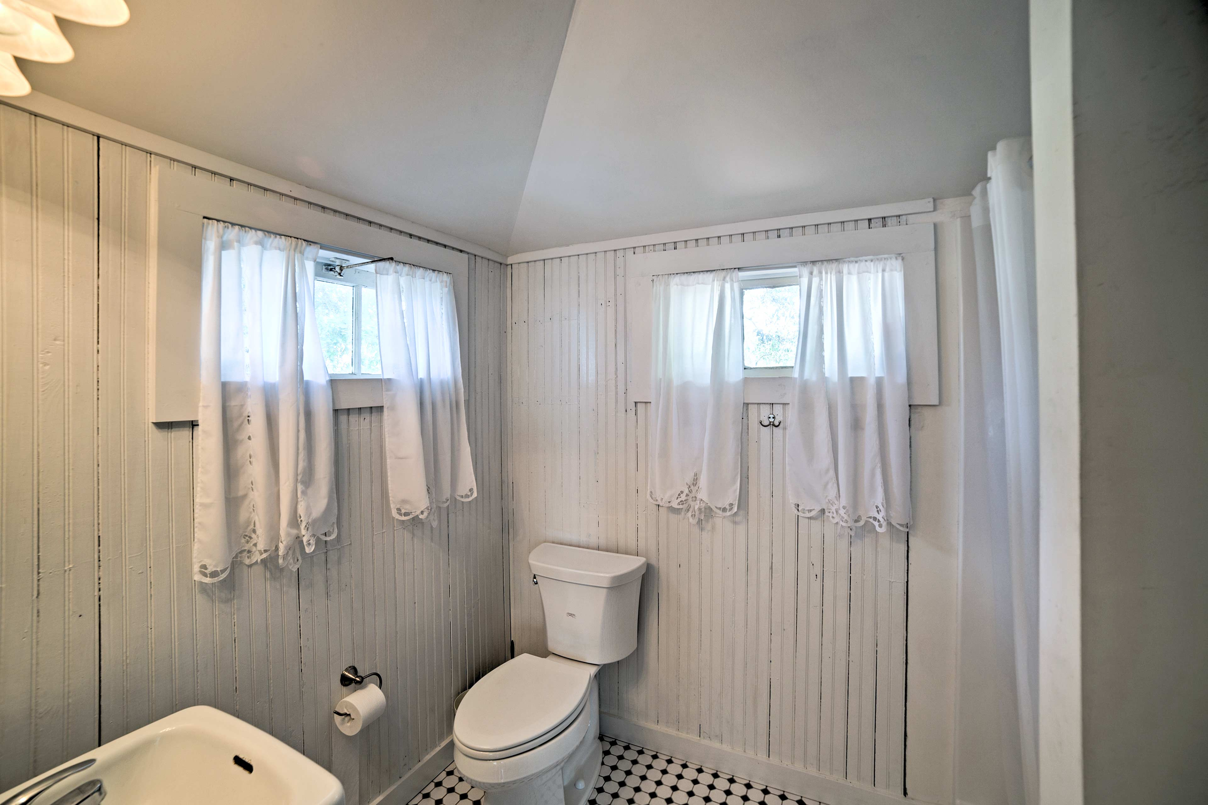 Prep for the day with ease in this private bathroom.