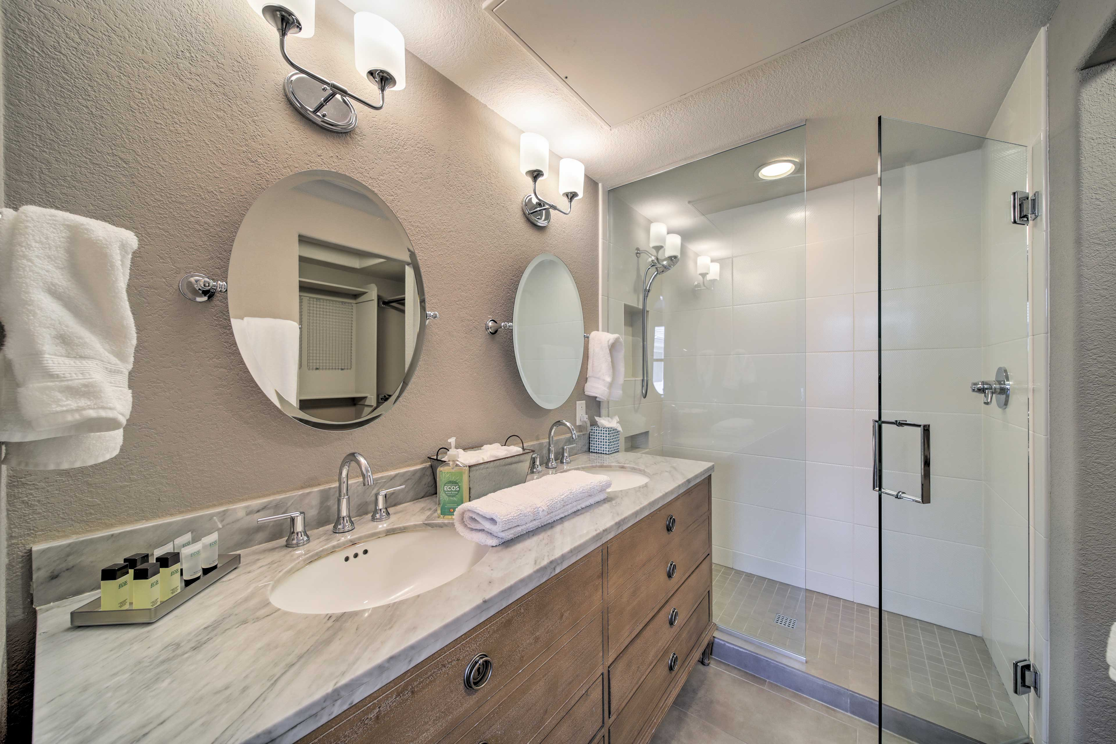 This top-notch bathroom is steps from the bed.