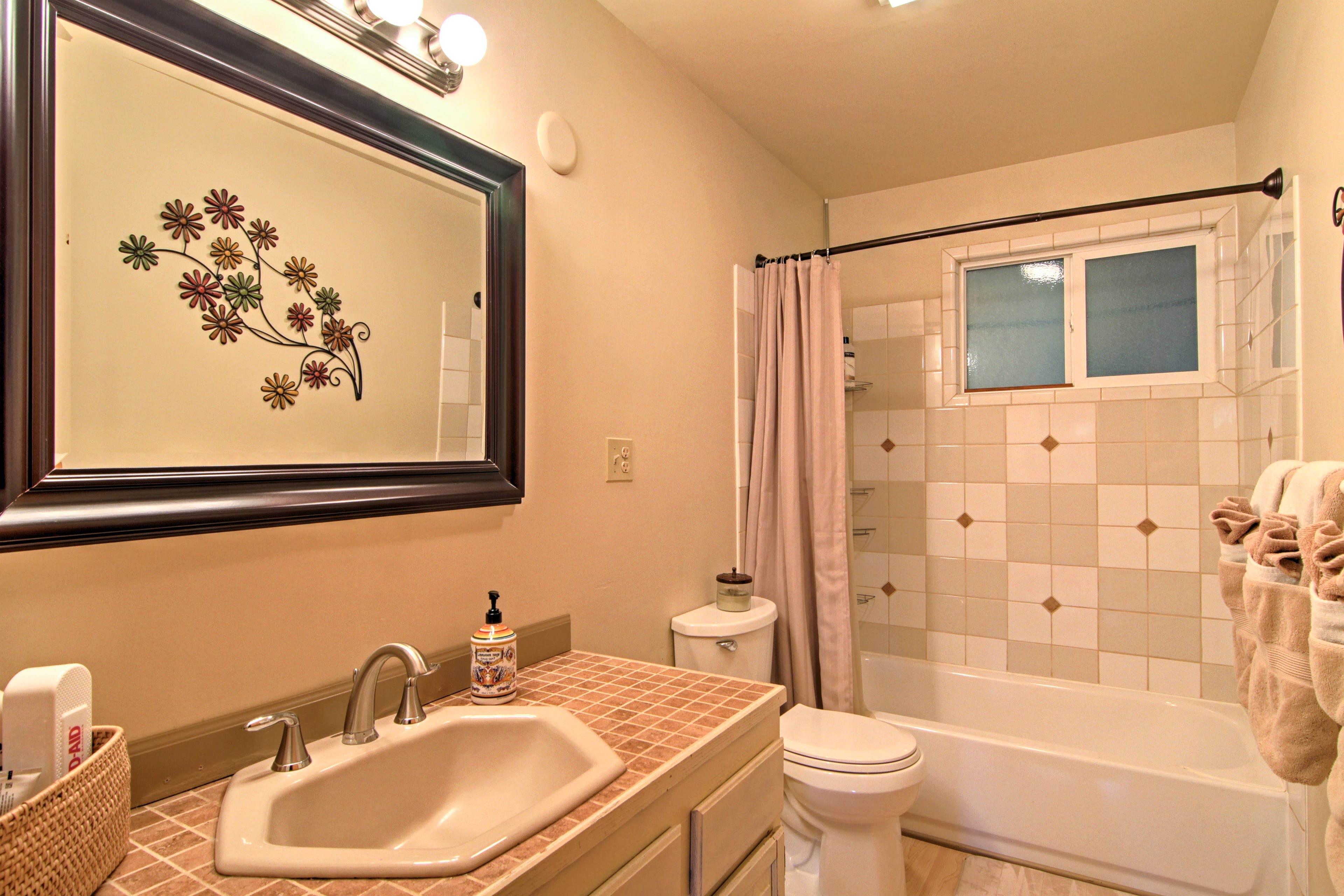 Take a bath or shower in the cute bathroom.