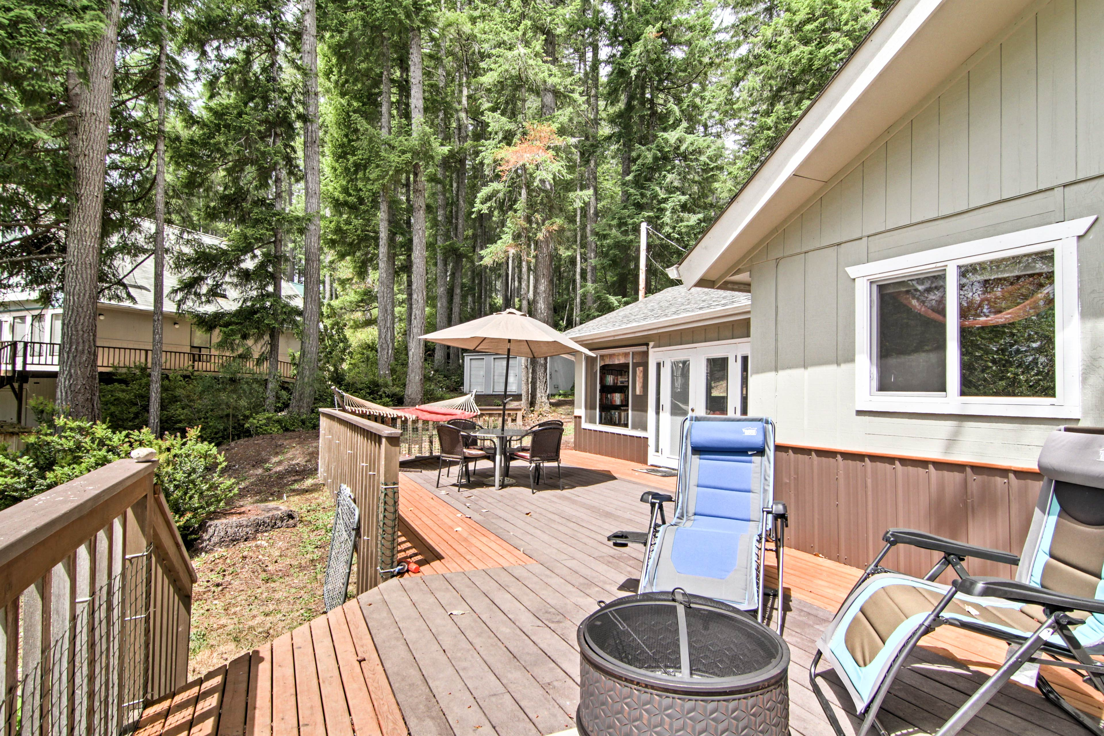 The spacious deck is an ideal spot to relax and unwind day or night.