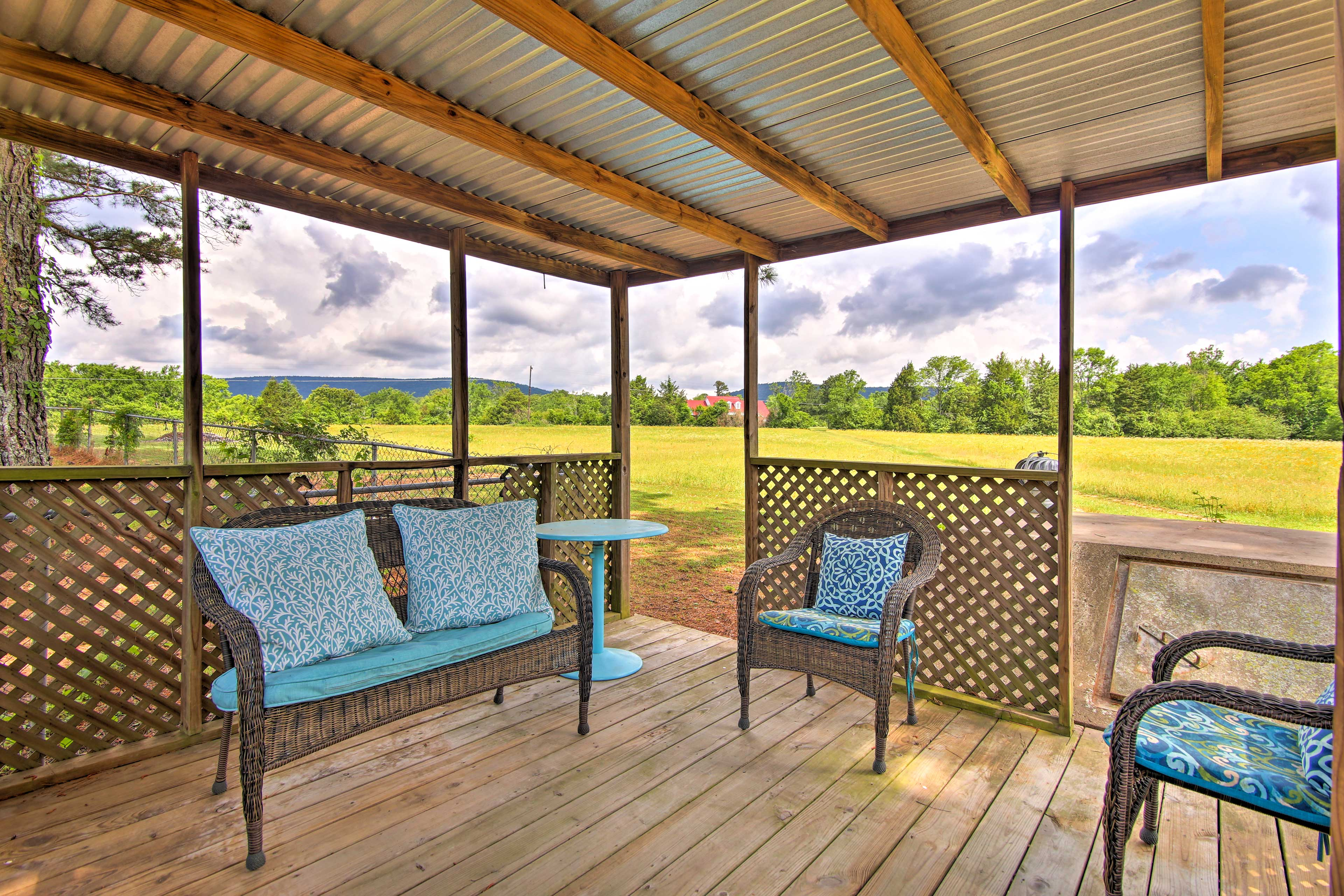 The property boasts a gazebo, fire pit, peaceful views, towering pines and more.