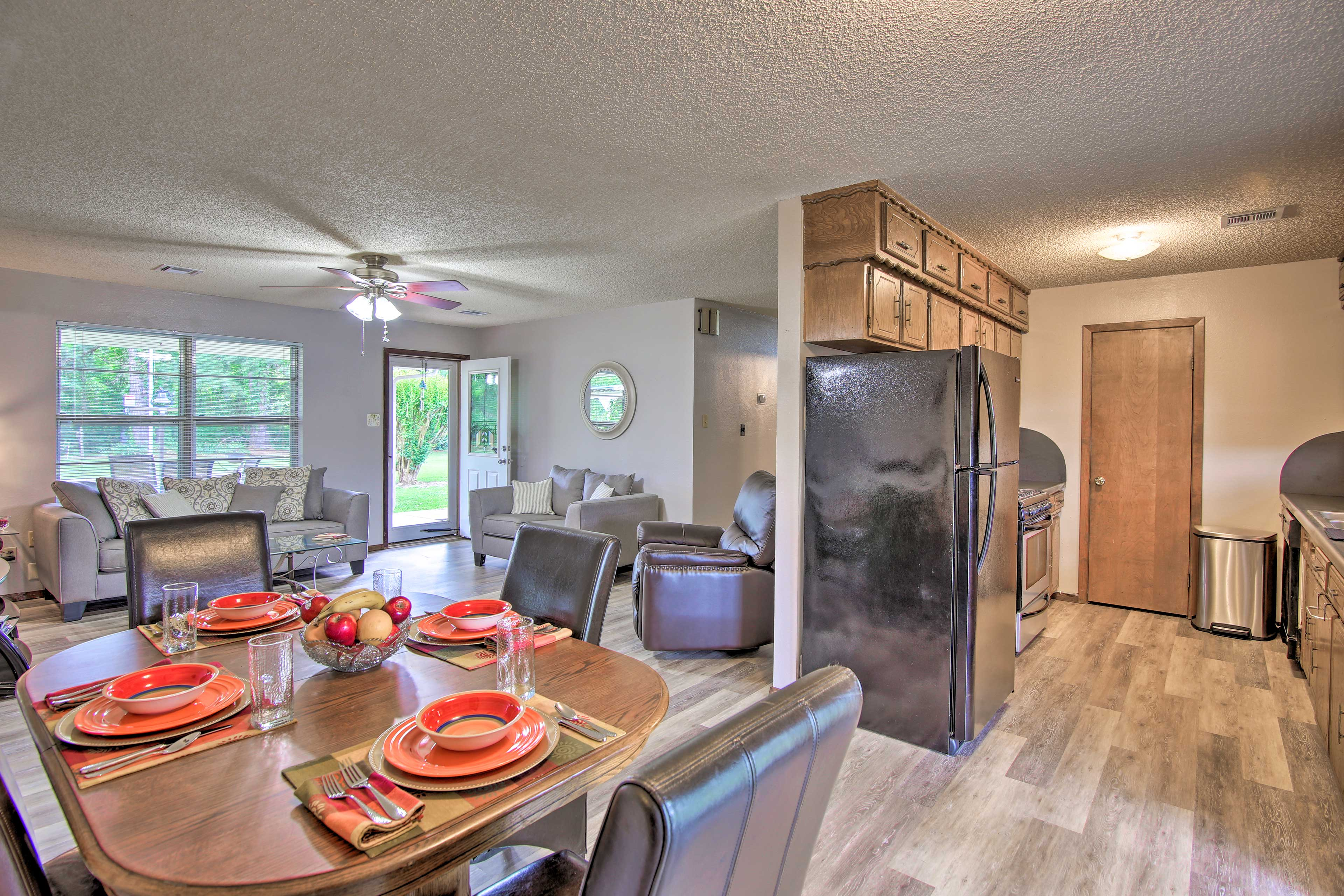 Gather around the 4-person dining table to savor home-cooked meals.
