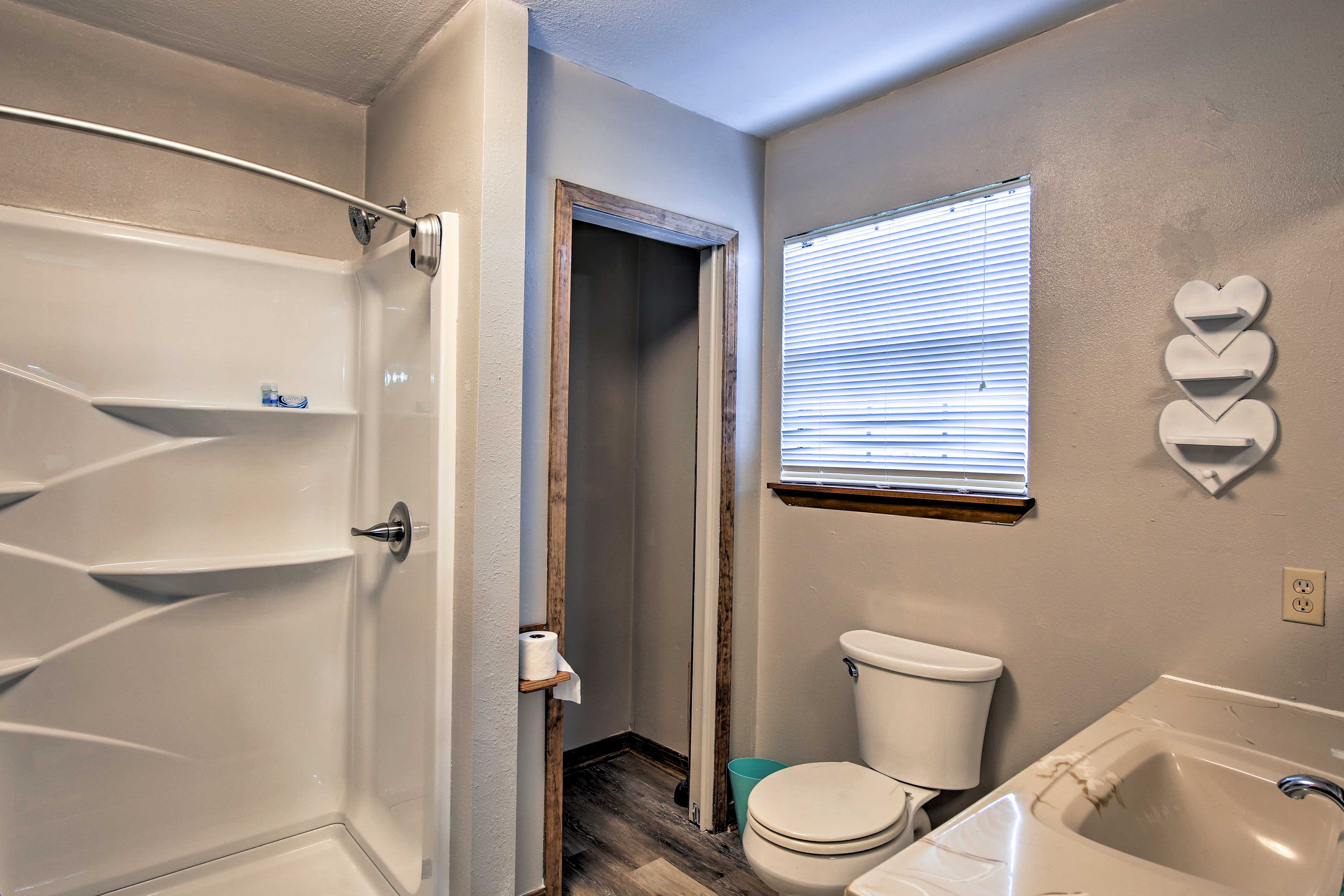 The master bathroom has a spacious walk-in shower.