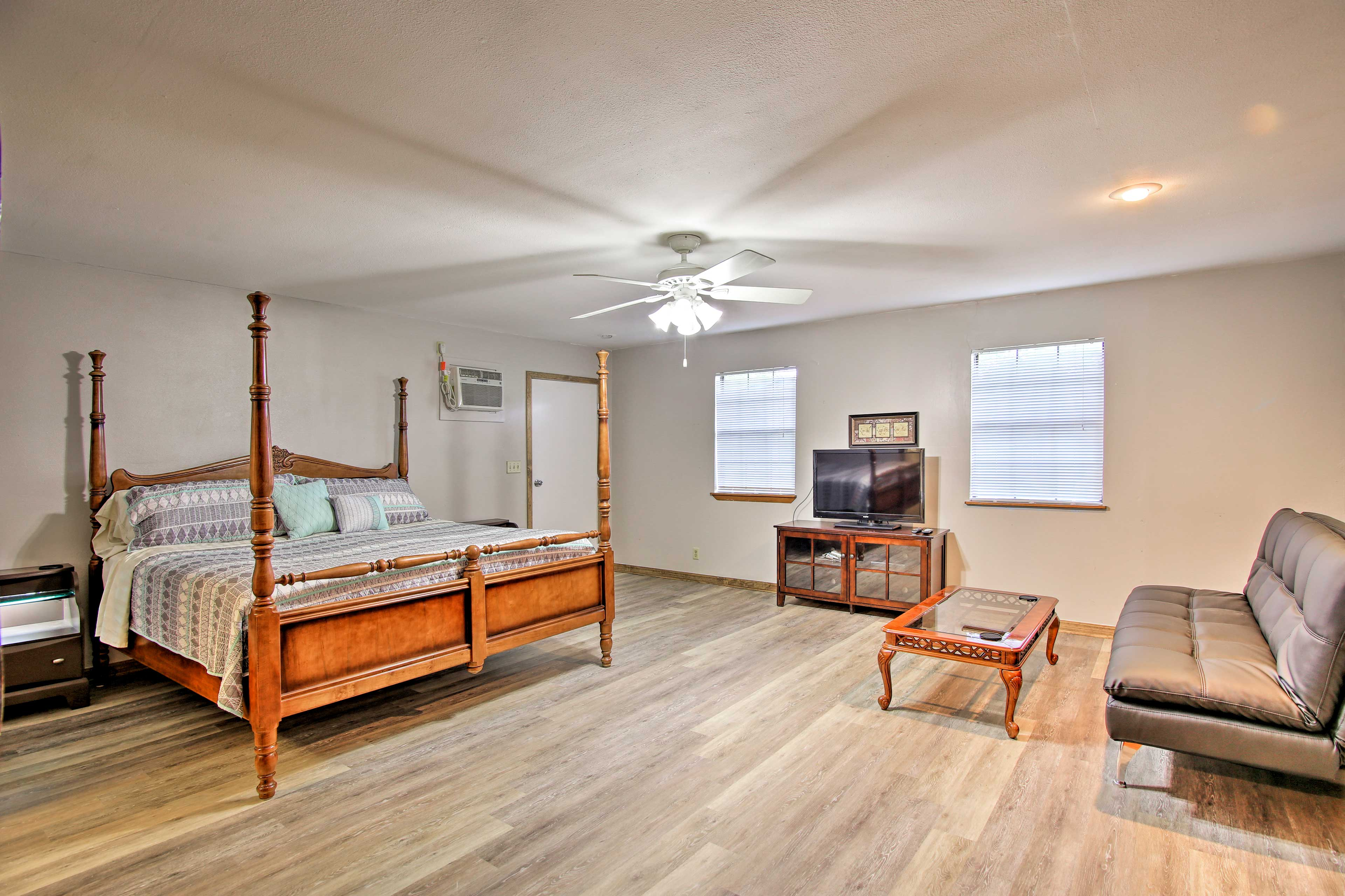 A plush king bed, flat-screen TV and futon furnish this massive bedroom.