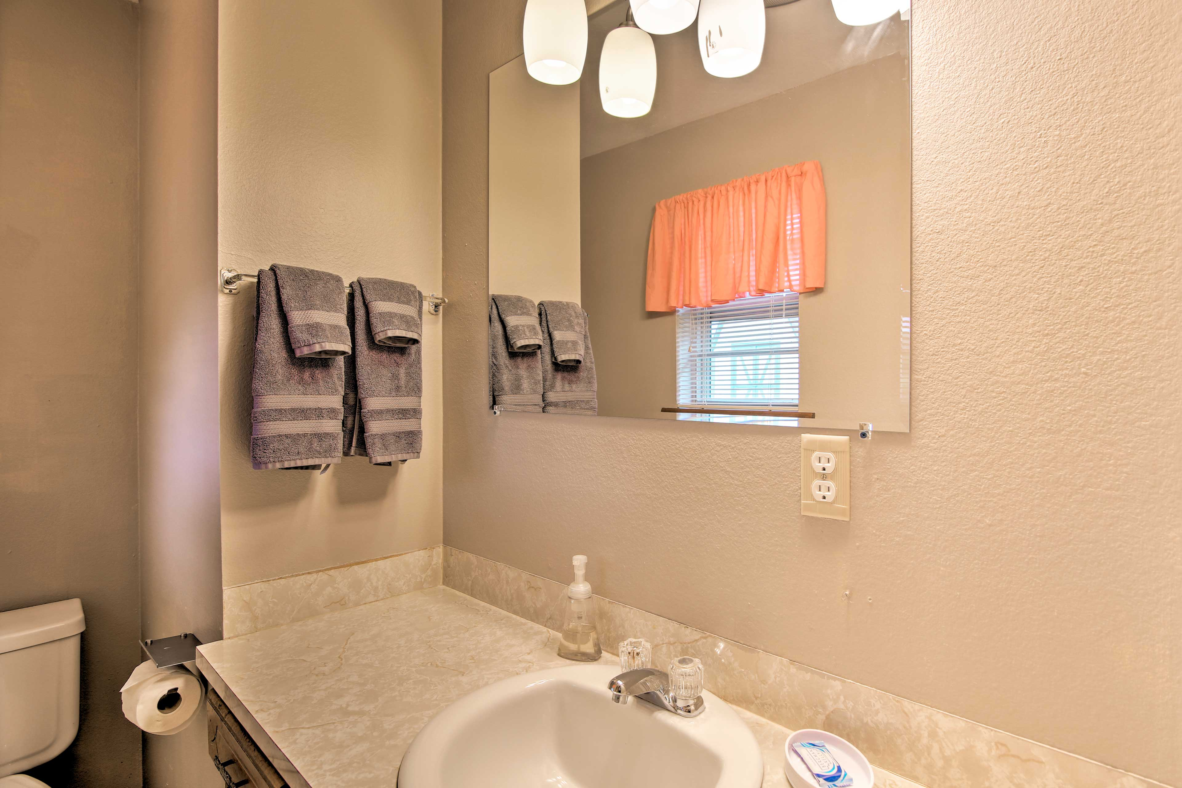 A second full bathroom provides full linens and towels.