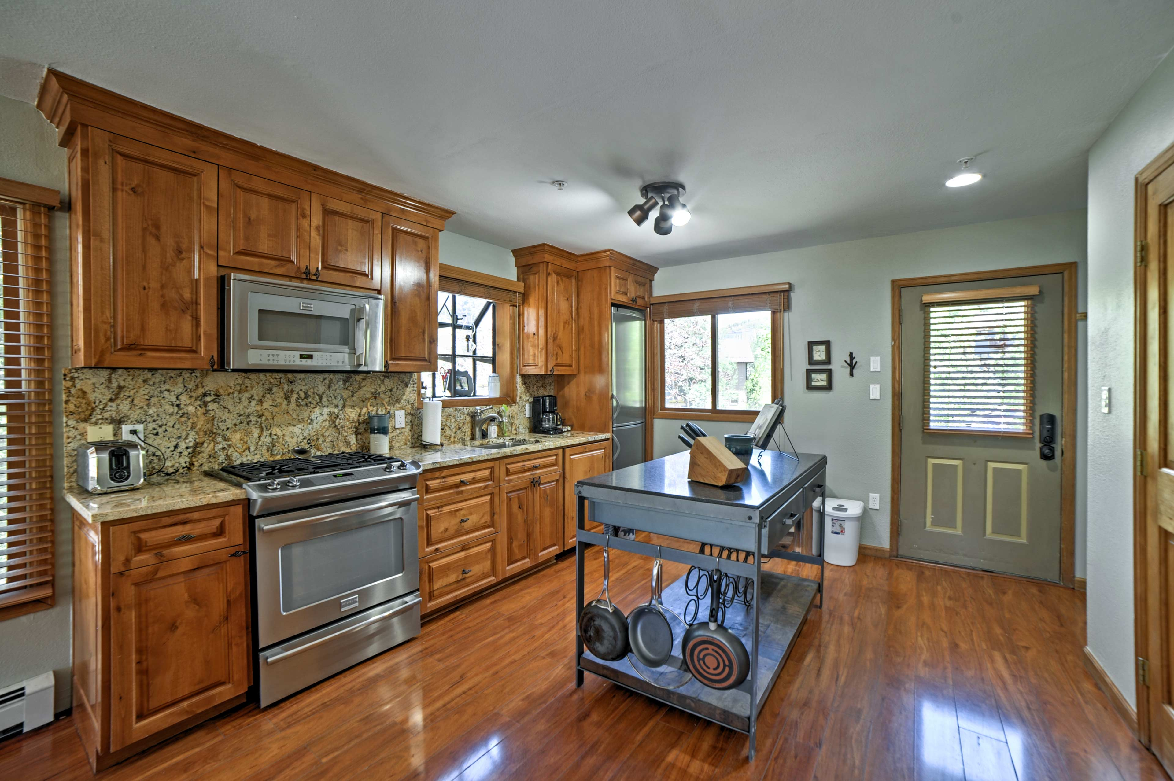 Utilize the fully equipped kitchen for home-cooked cuisine.