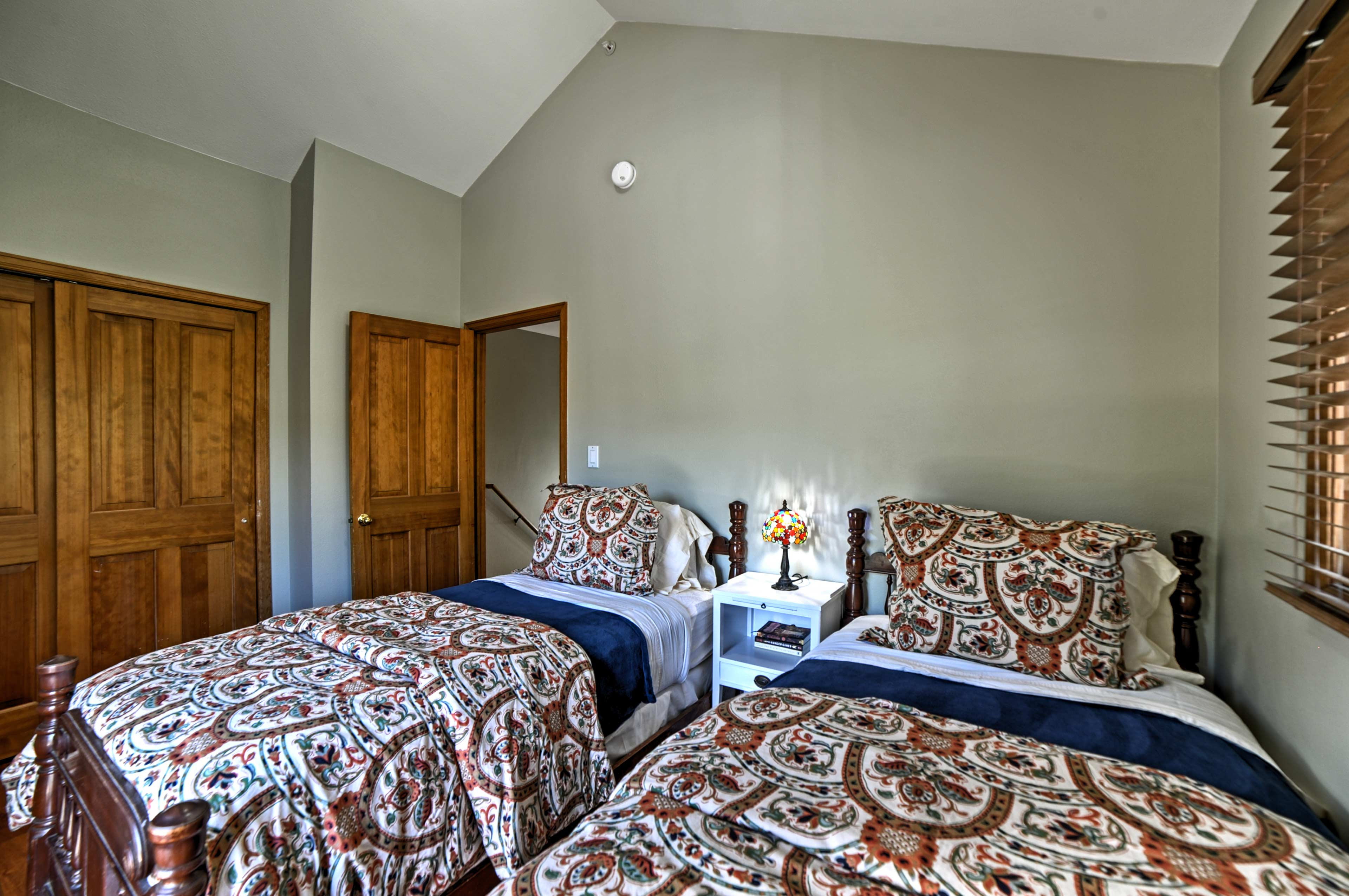 This first bedroom contains 2 twin-sized beds.