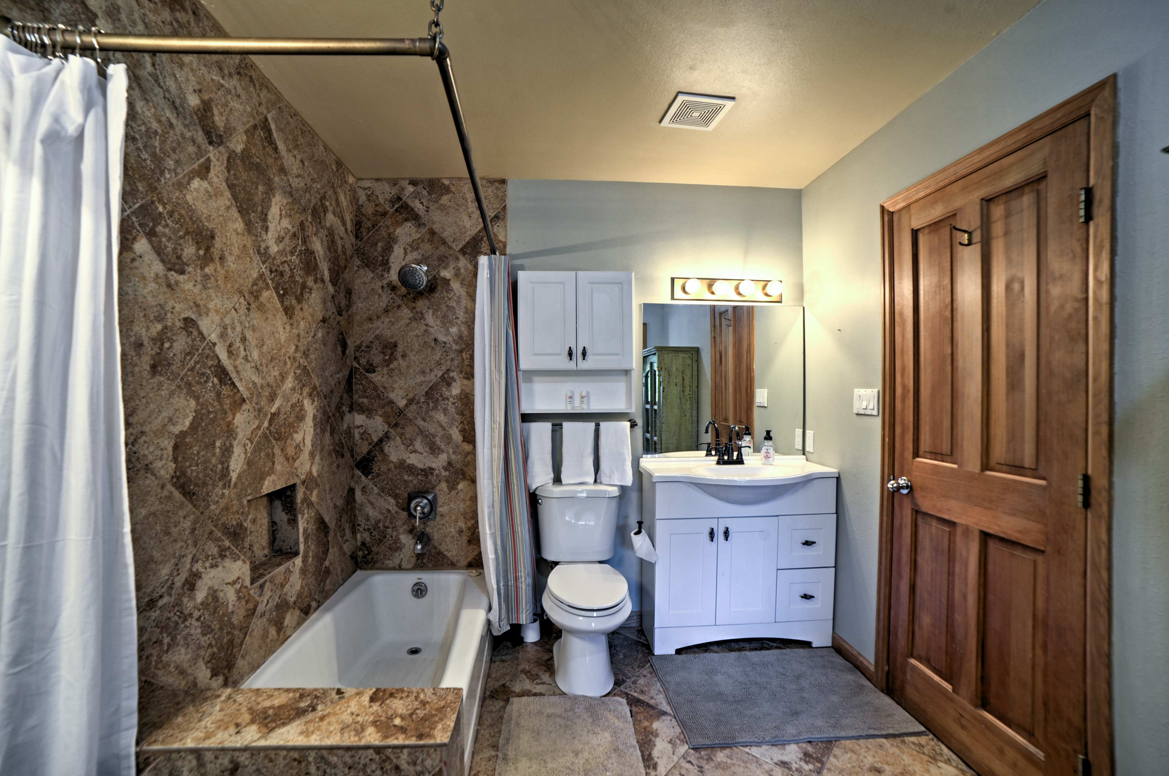 Rinse off in the updated tub/shower combo.