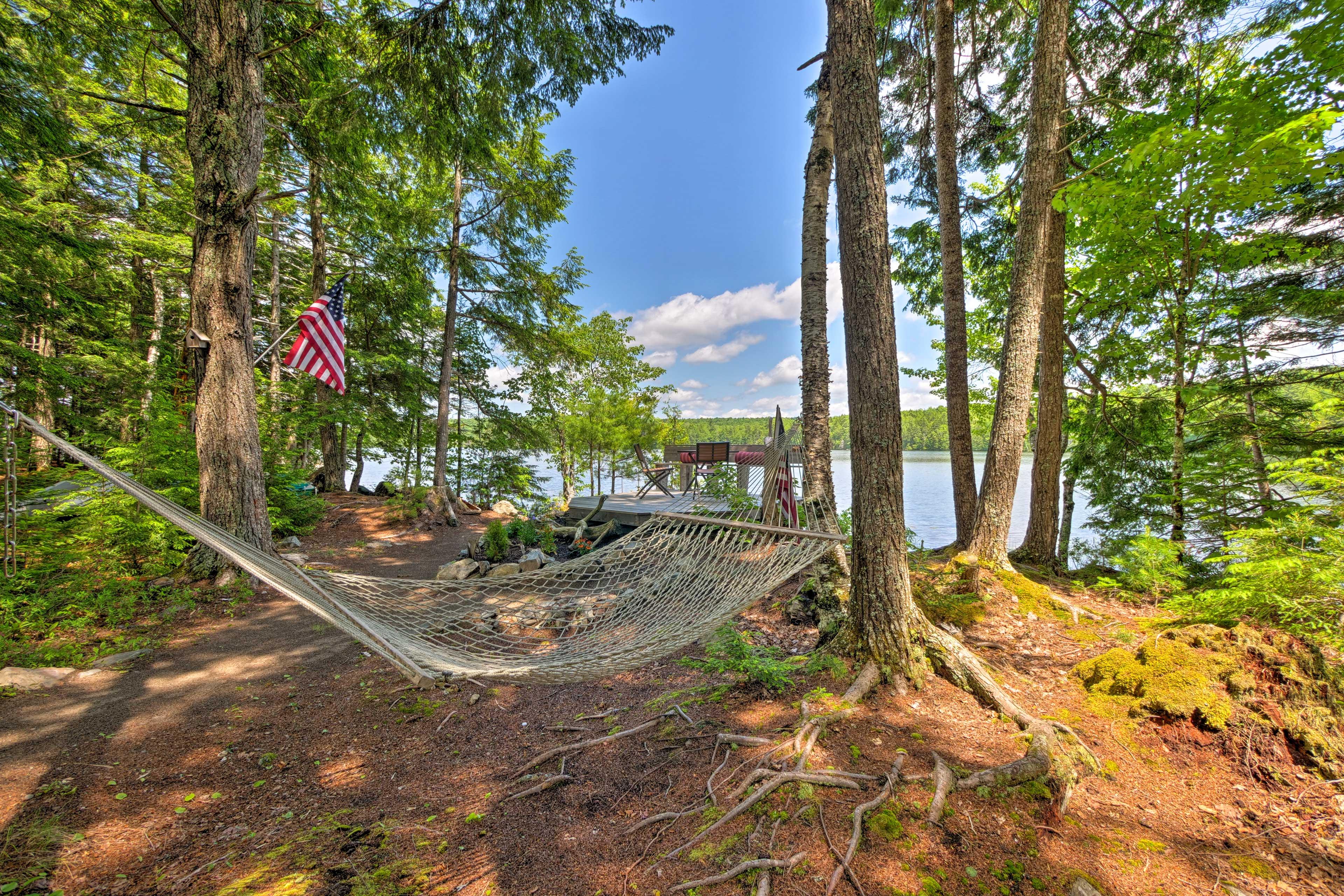 Enjoy lakeside leisure at this 2-bedroom, 1-bathroom Great Pond, Maine cottage!