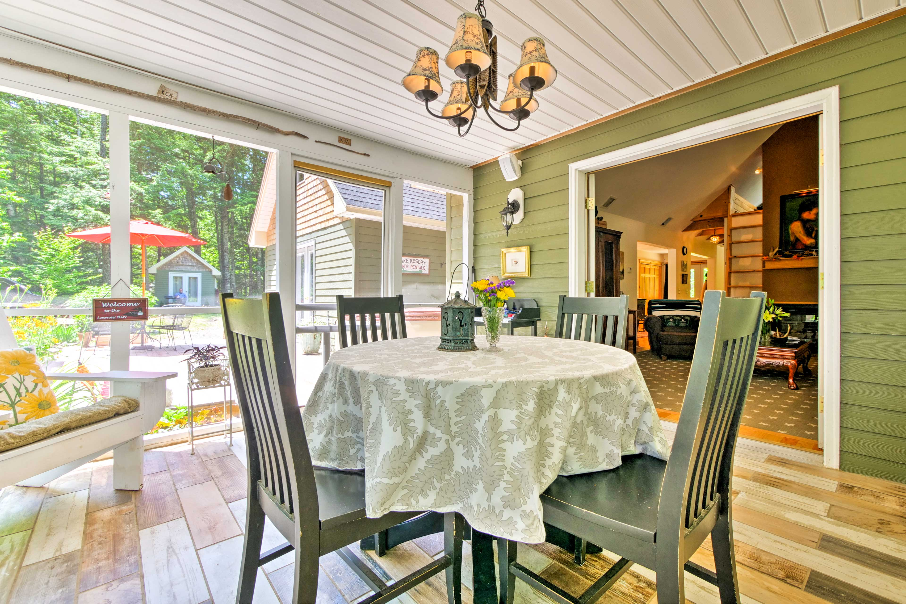 Enjoy the panoramic views of nature from the table in the screened-in porch.