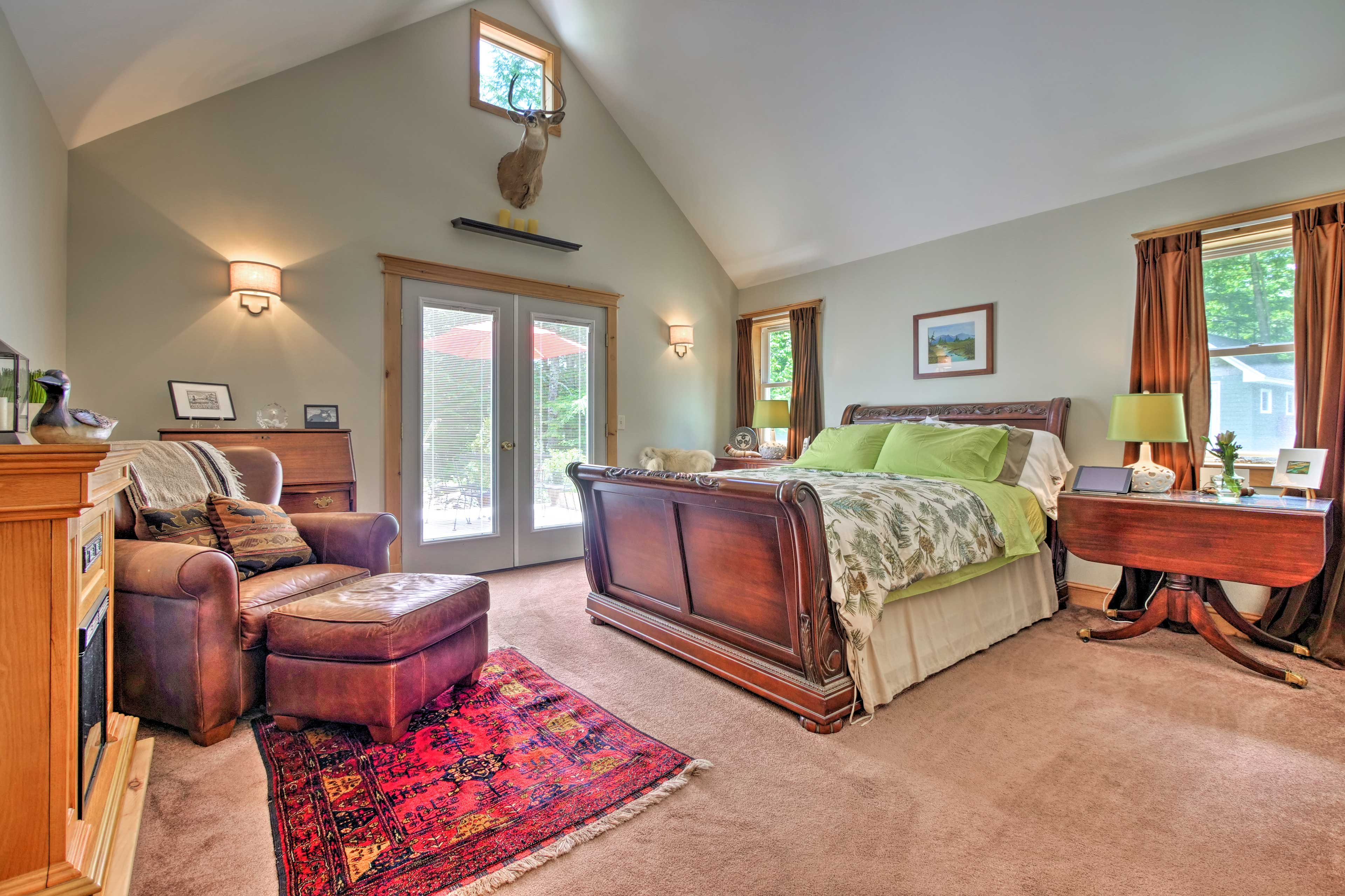 Cathedral ceilings welcome you into the master bedroom with a queen bed.