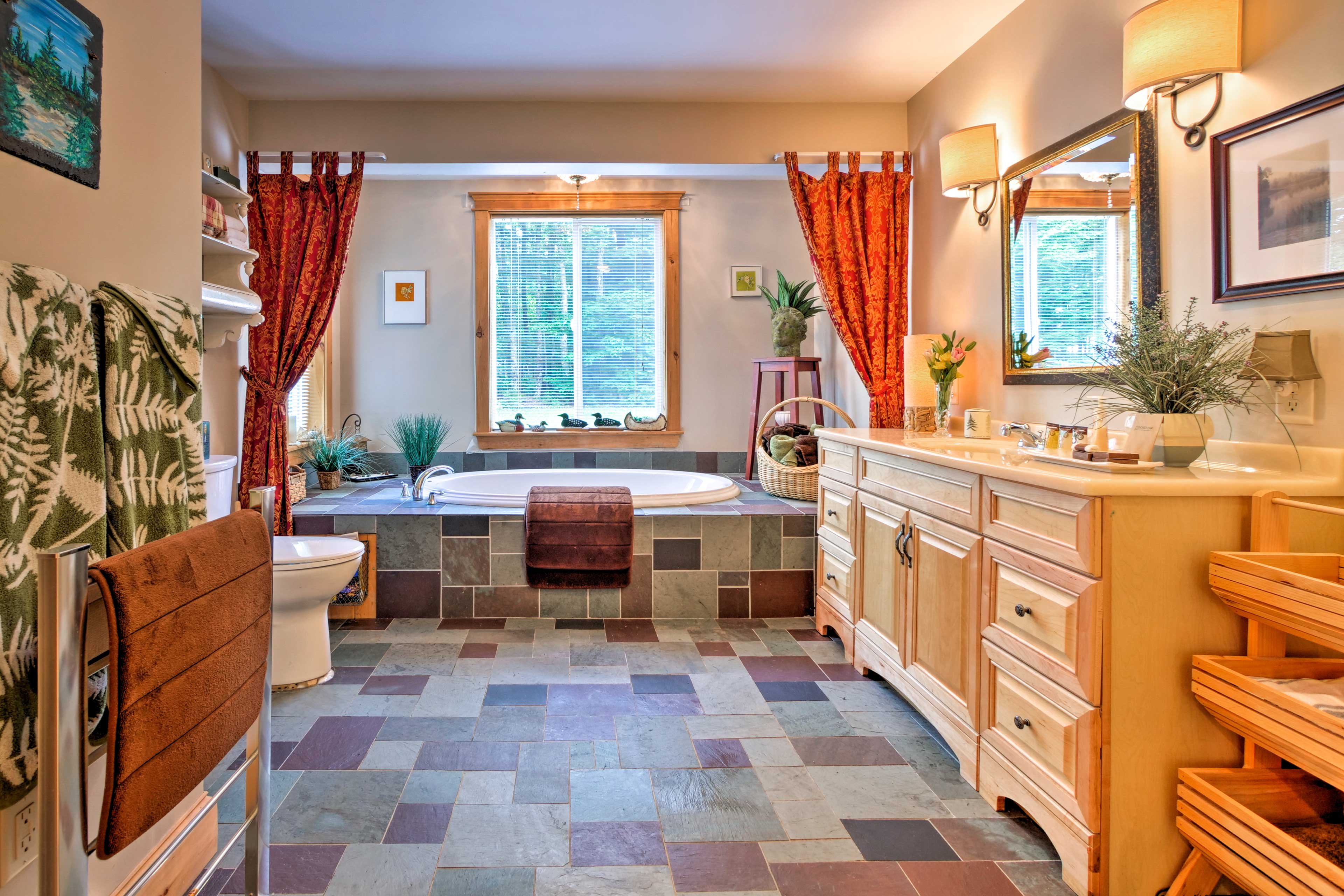 Everyone will enjoy this spa-inspired bathroom with a jetted jacuzzi tub.