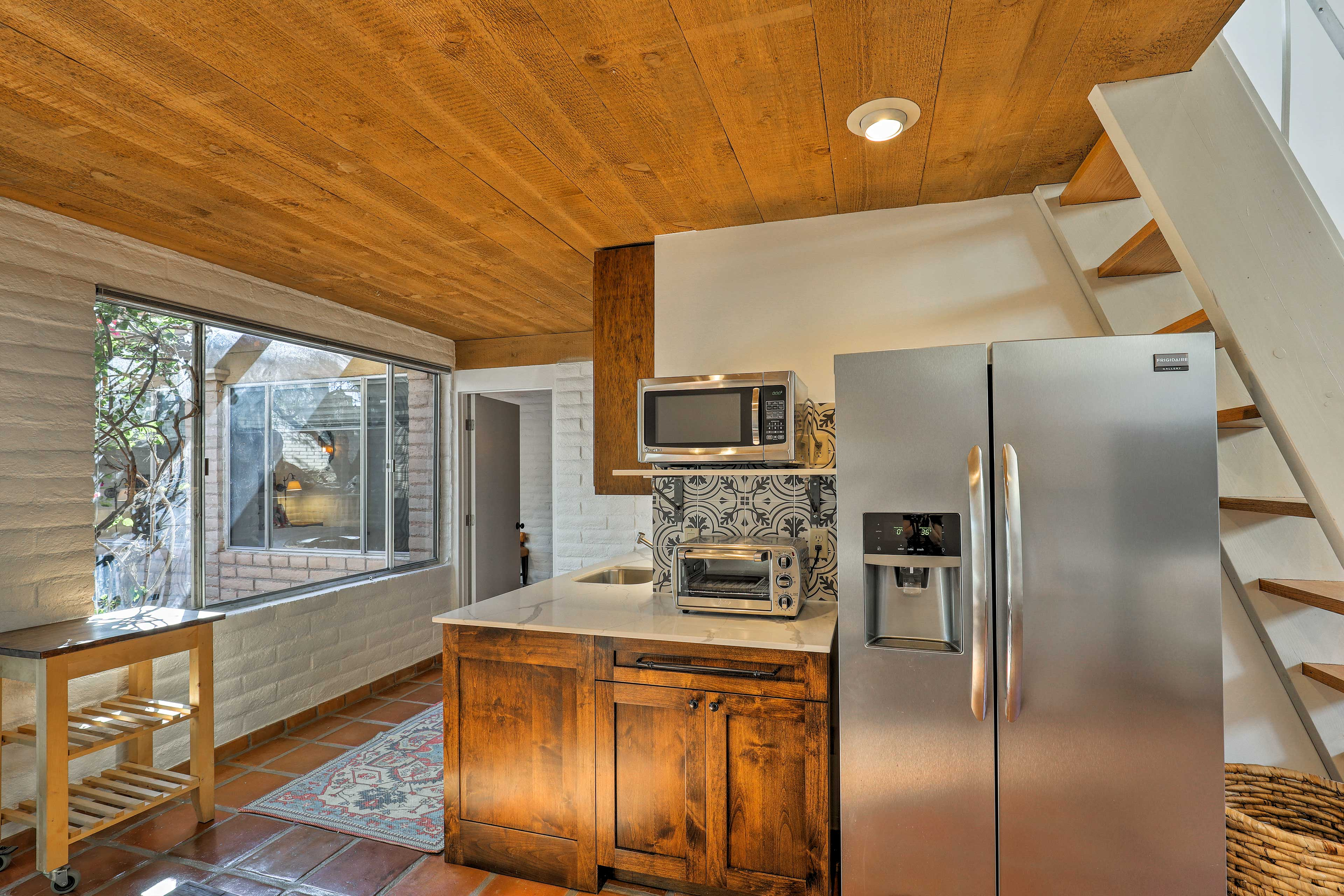The well-equipped kitchenette boasts stainless steel appliances.