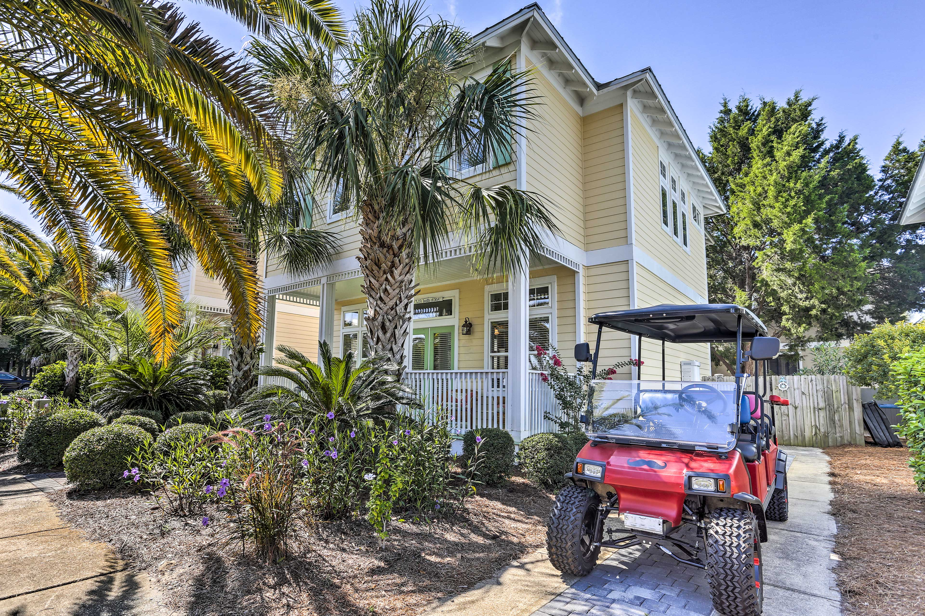 Drive around in a golf cart when you book this Santa Rosa Beach vacation rental.