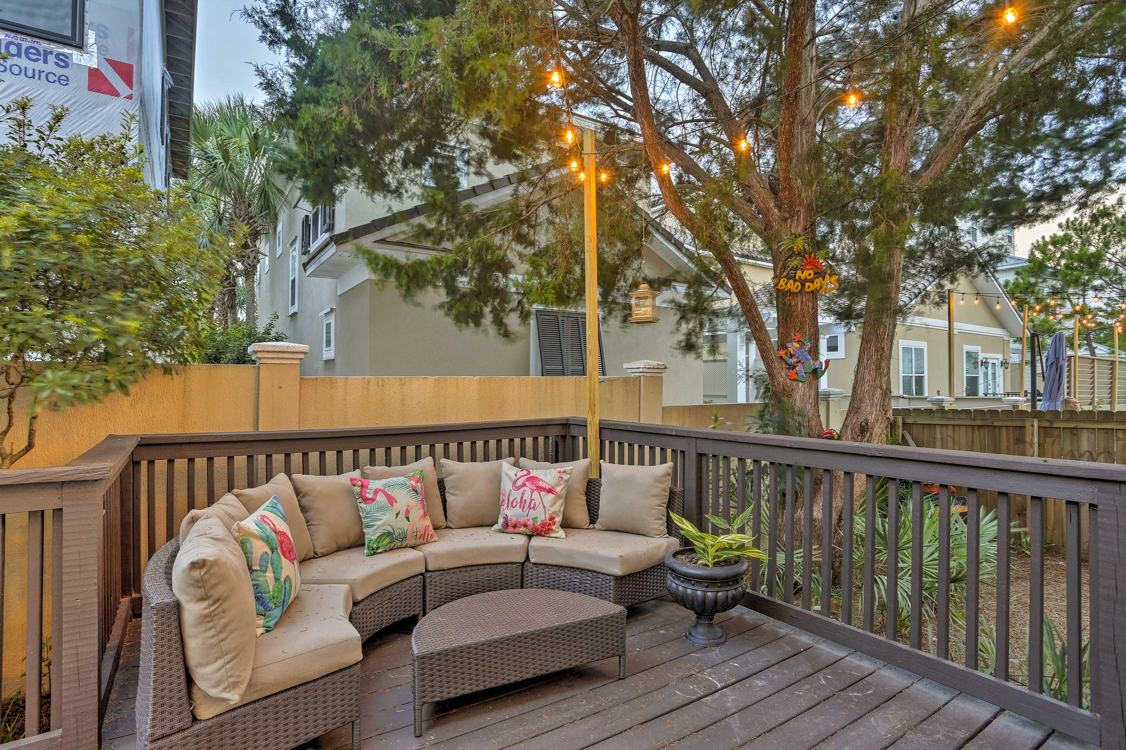 The home offers a spacious deck with comfortable outdoor seating.
