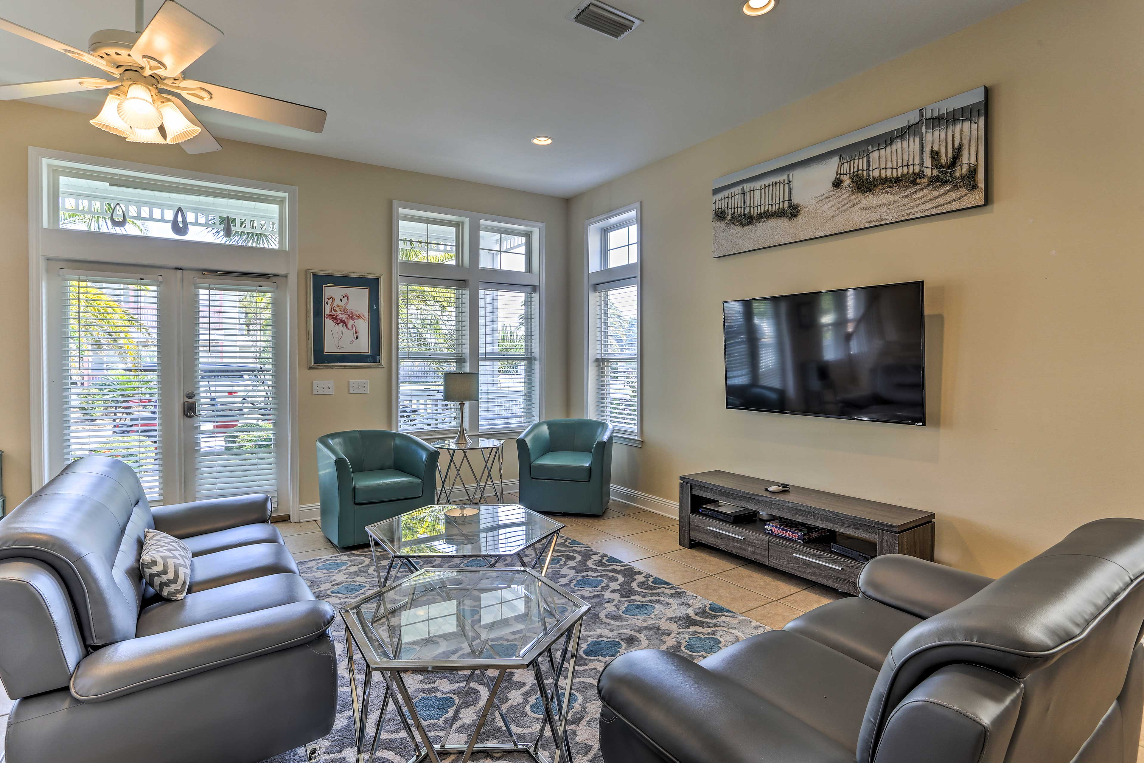 Unwind in the living room and watch shows on the 70-inch flat-screen cable TV.