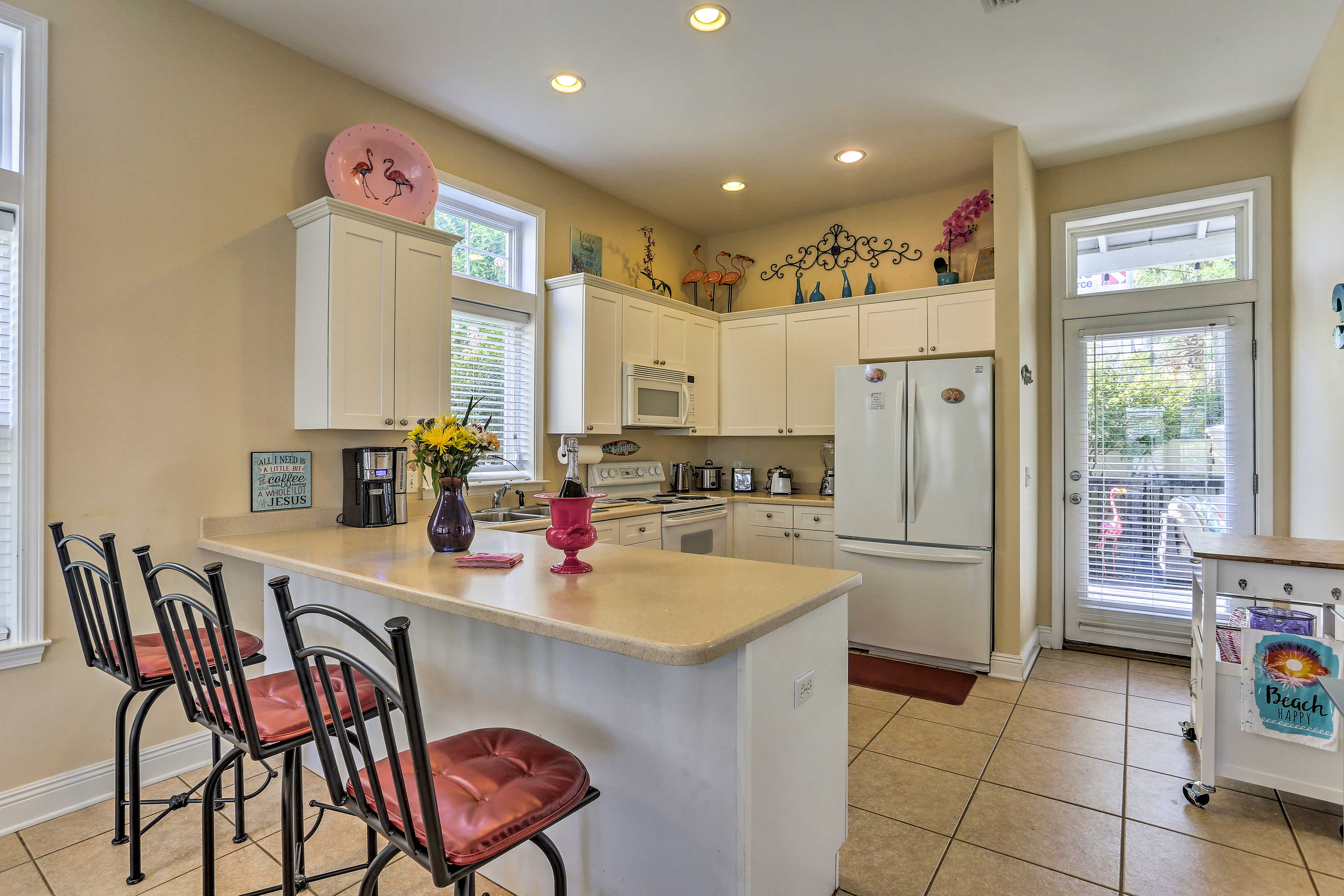 Grab a spot at the 4-person breakfast bar to snack and visit.