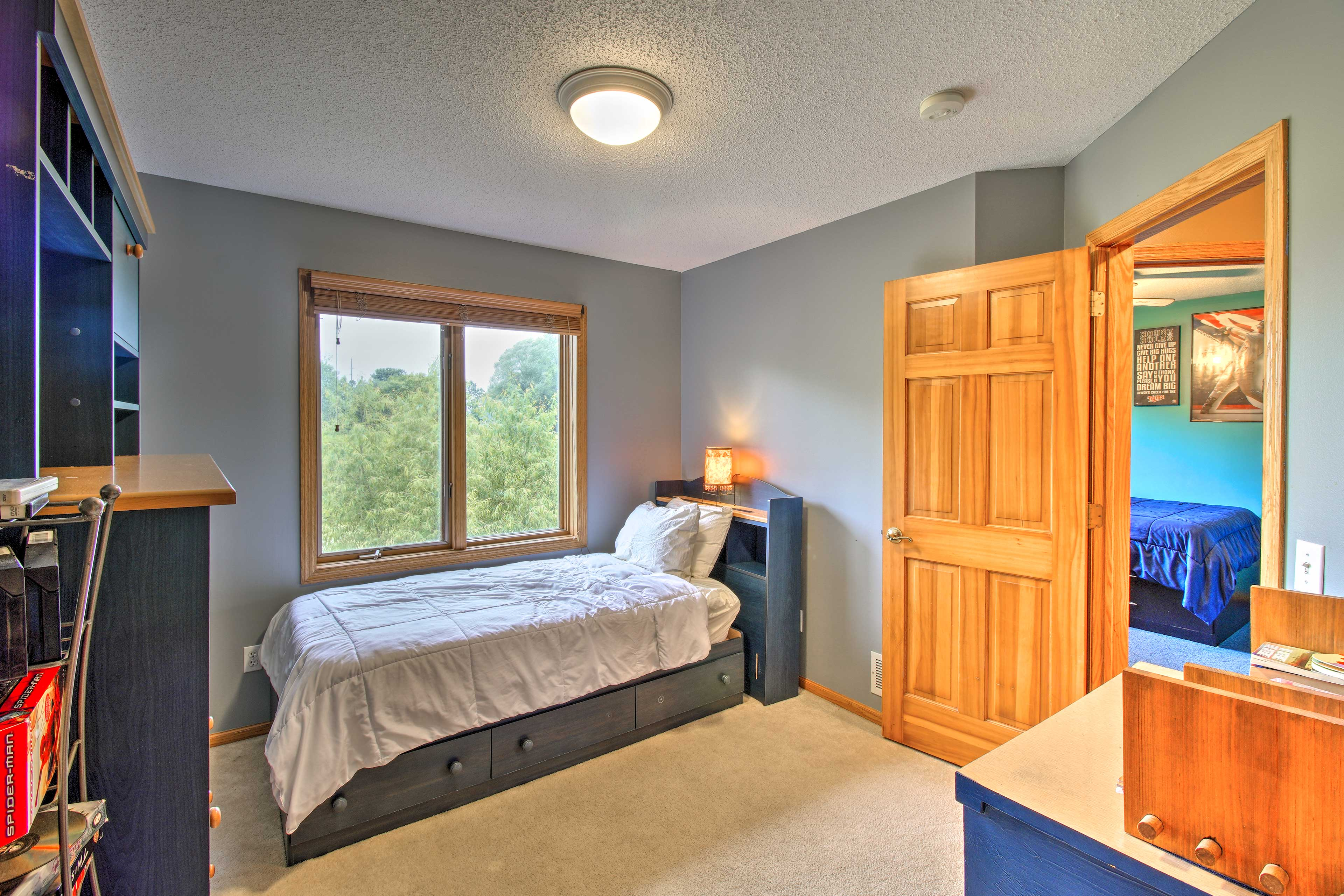 This twin bedroom is perfect for one of the kids.