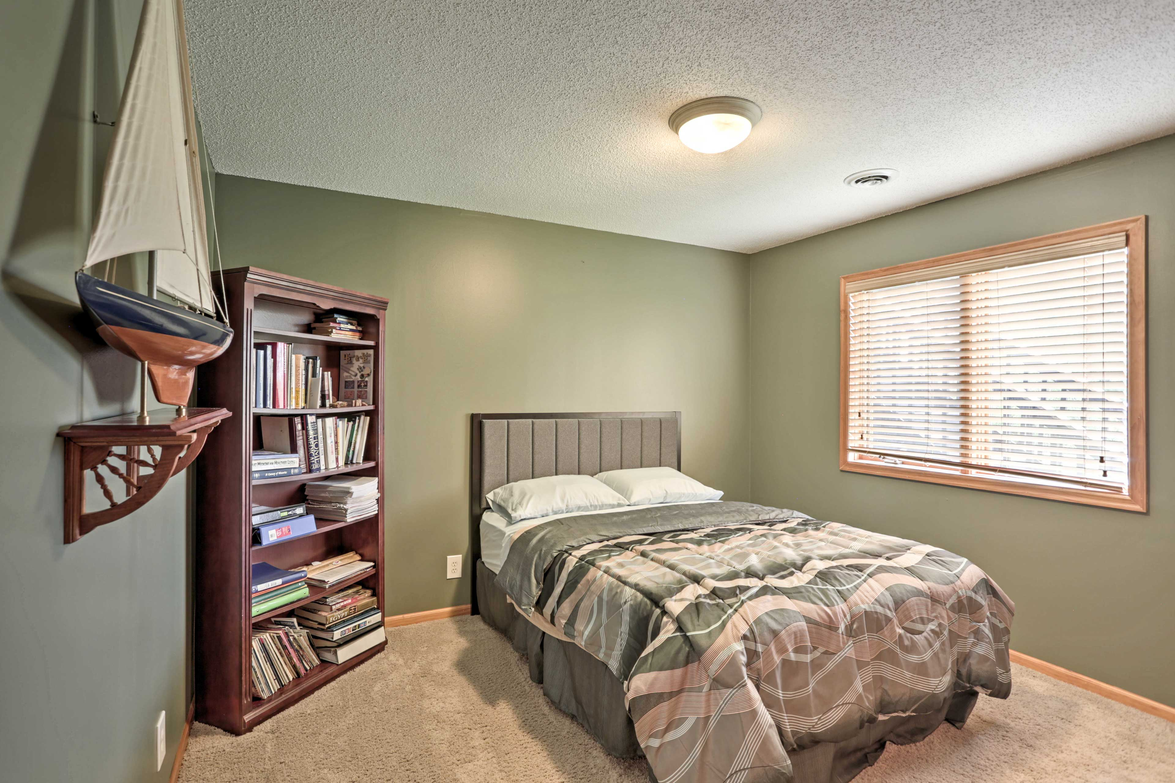 Cozy up in the full bed in this second bedroom.