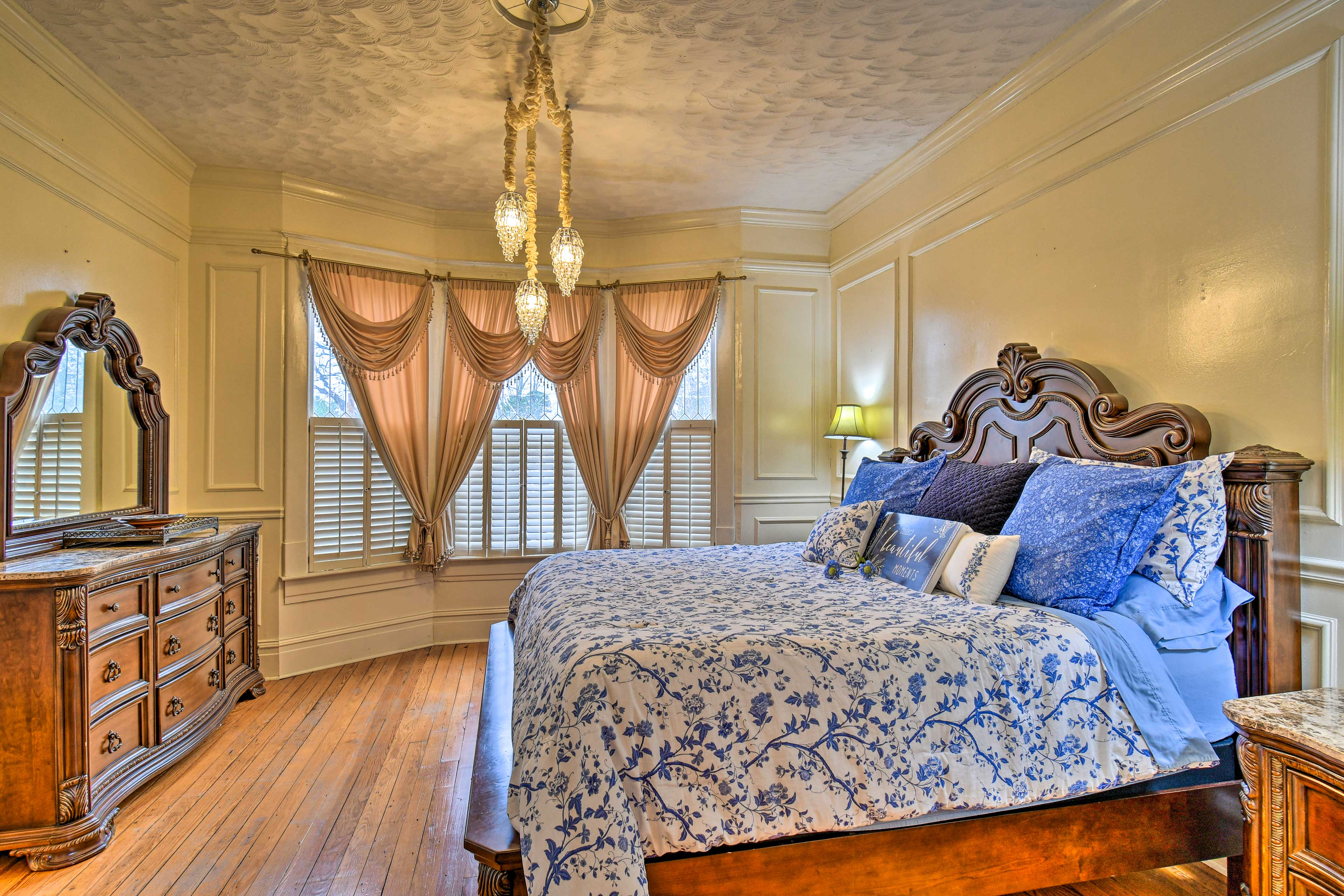 The master bedroom is adjacent to the dining room.
