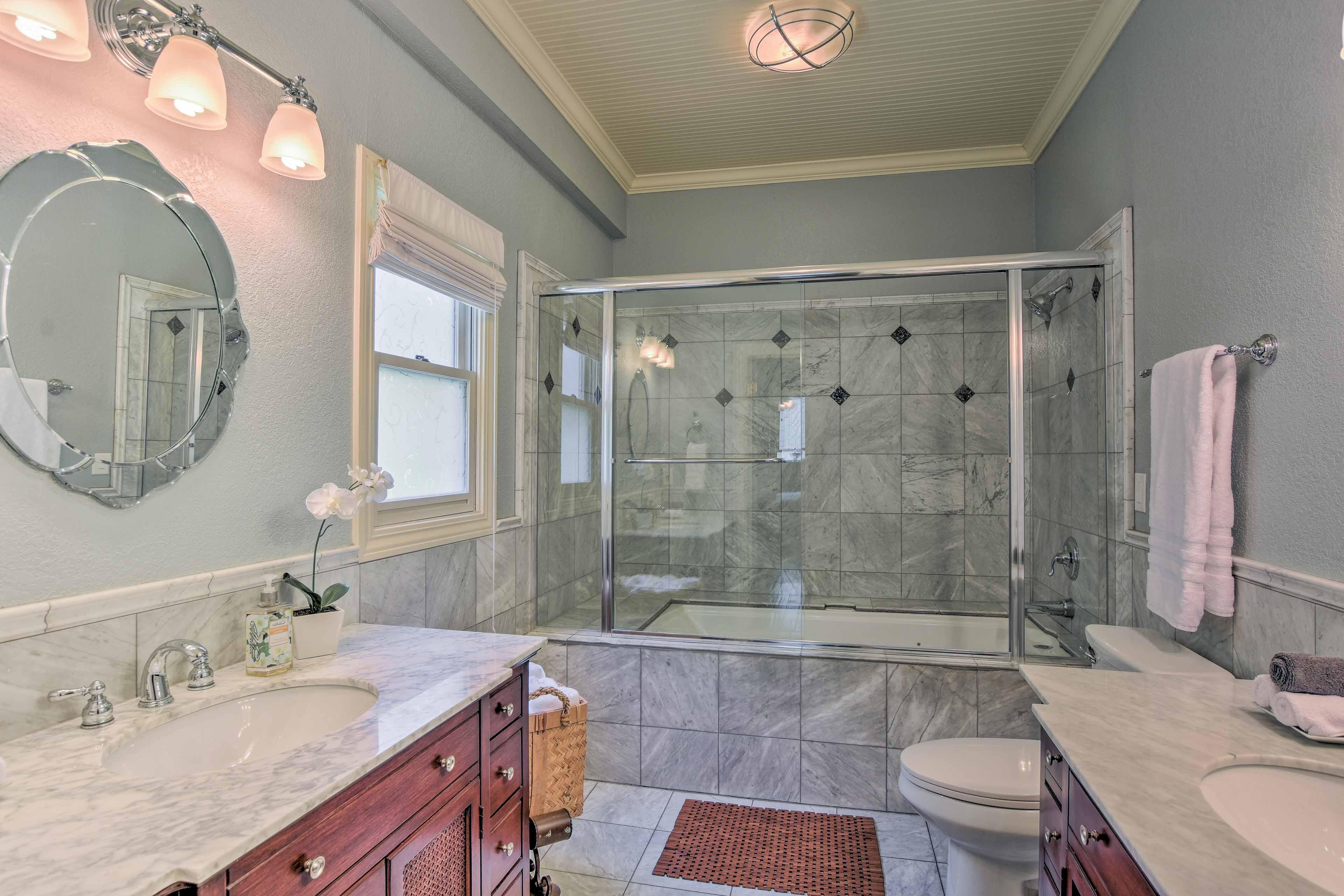 Italian marble completes the elegant en-suite bathroom.