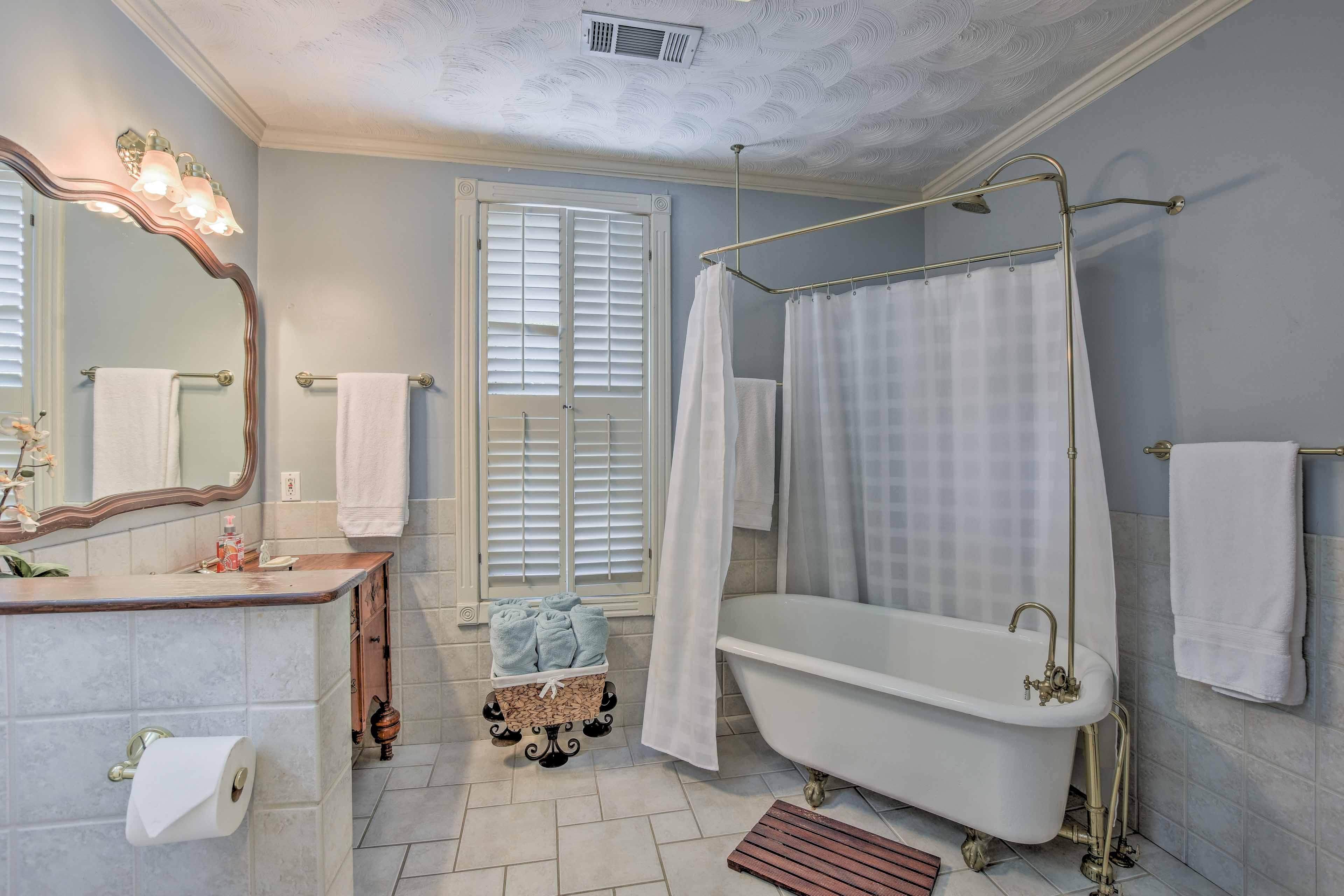 Soak in the original claw-foot bathtub.