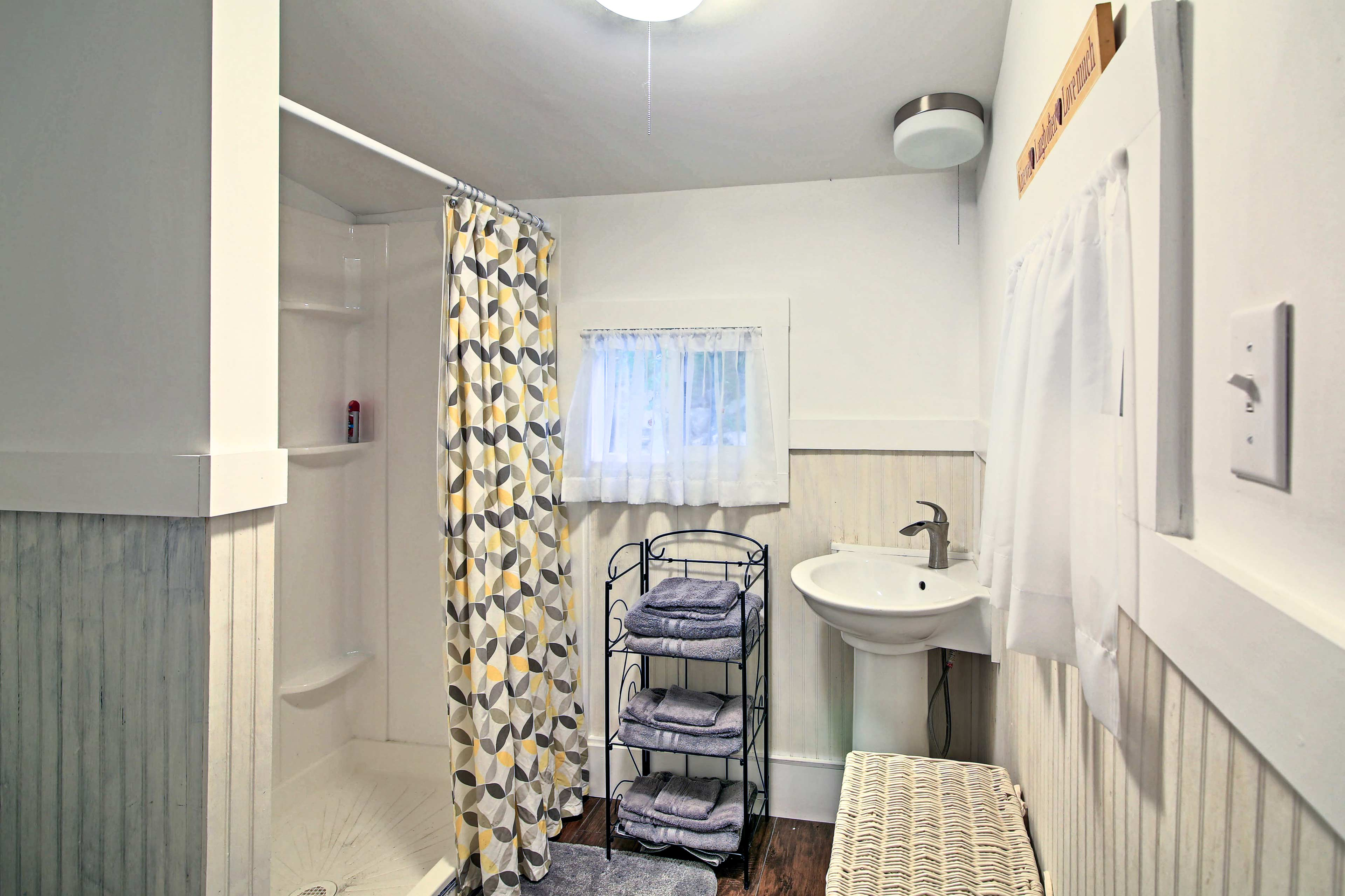 Wash off in this walk-in shower.