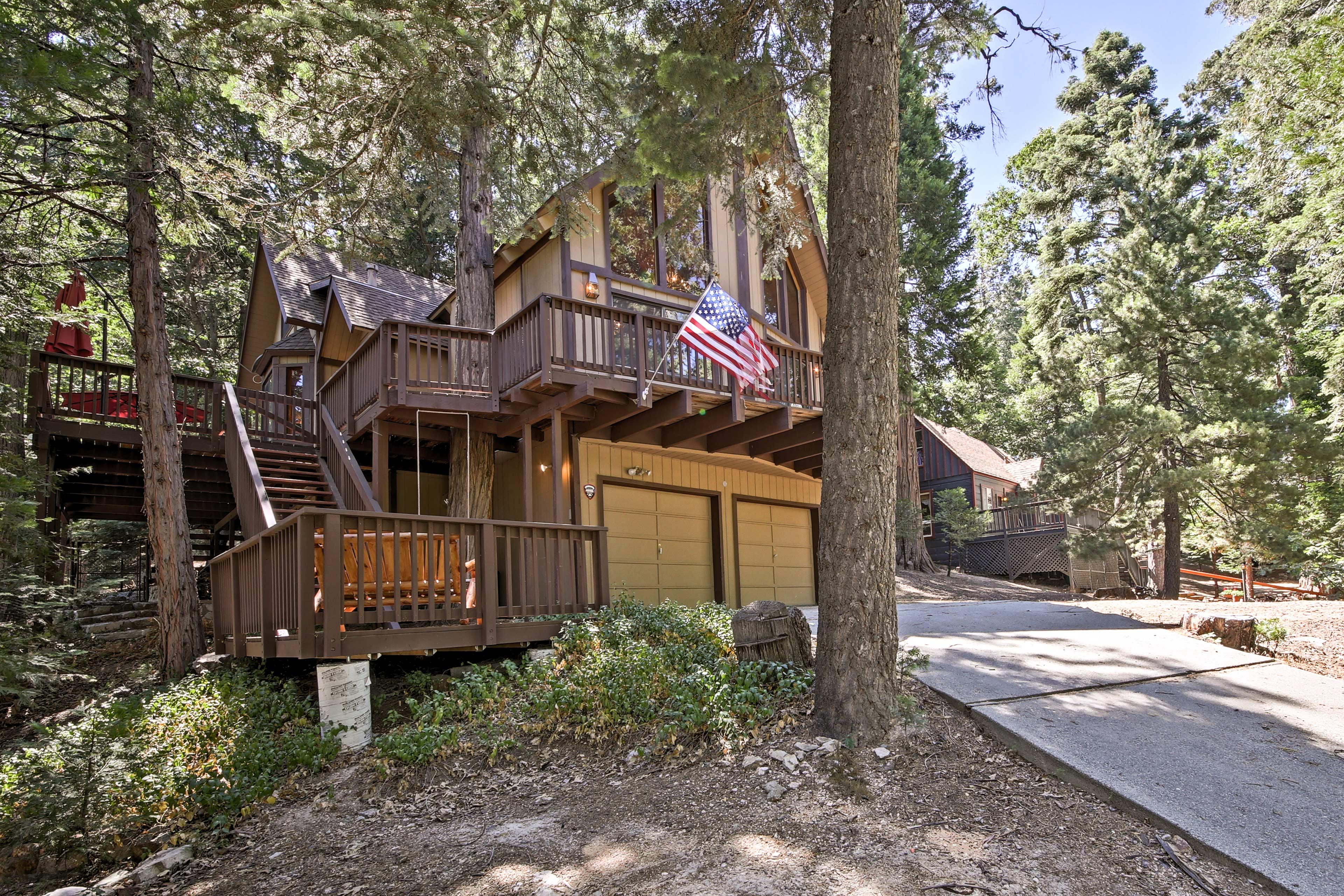 The 4-bedroom, 3-bathroom house has a wraparound deck, hammock and hot tub.