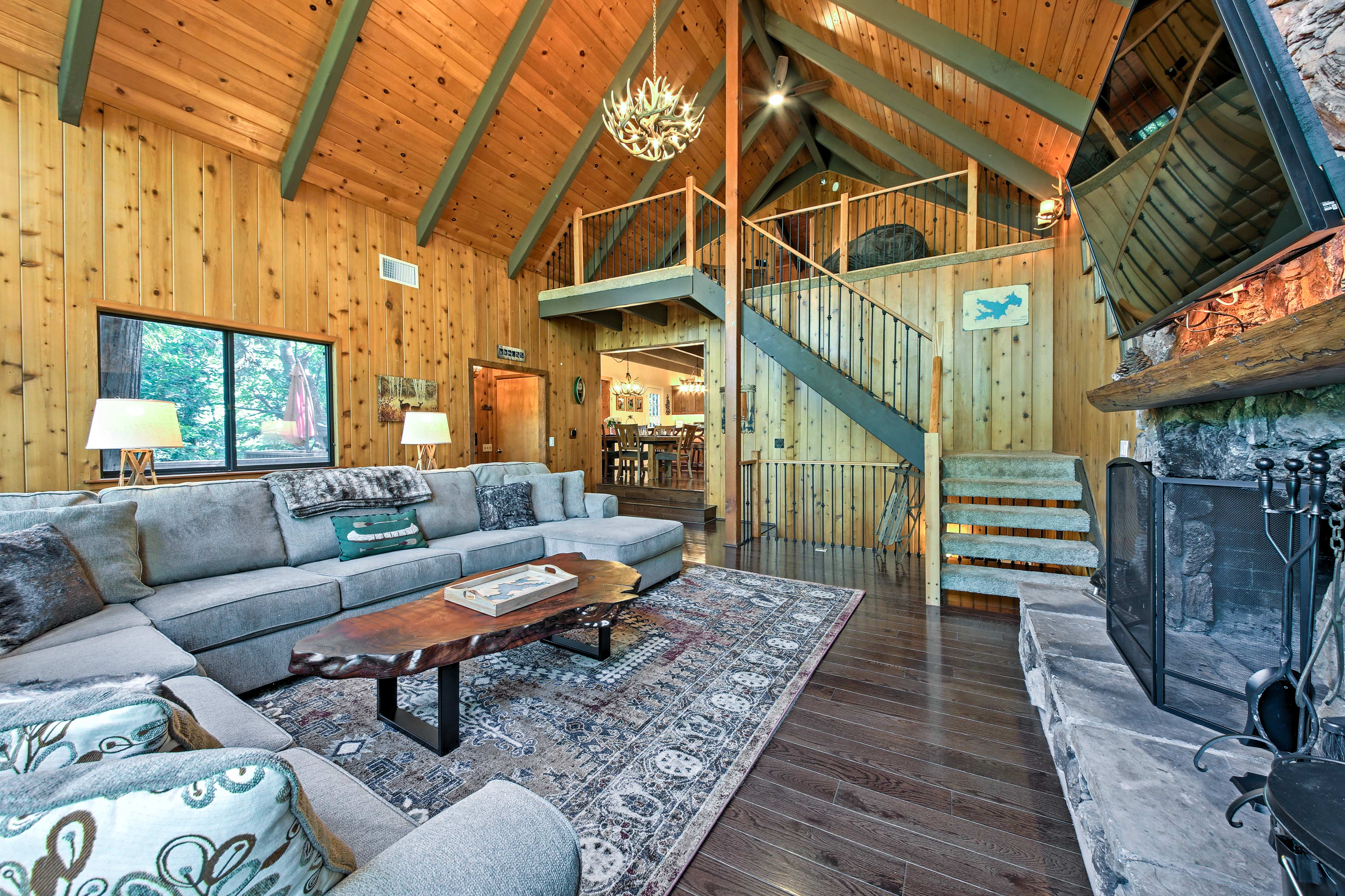Vaulted ceilings, hardwood floors and rustic cabin decor detail the interior.