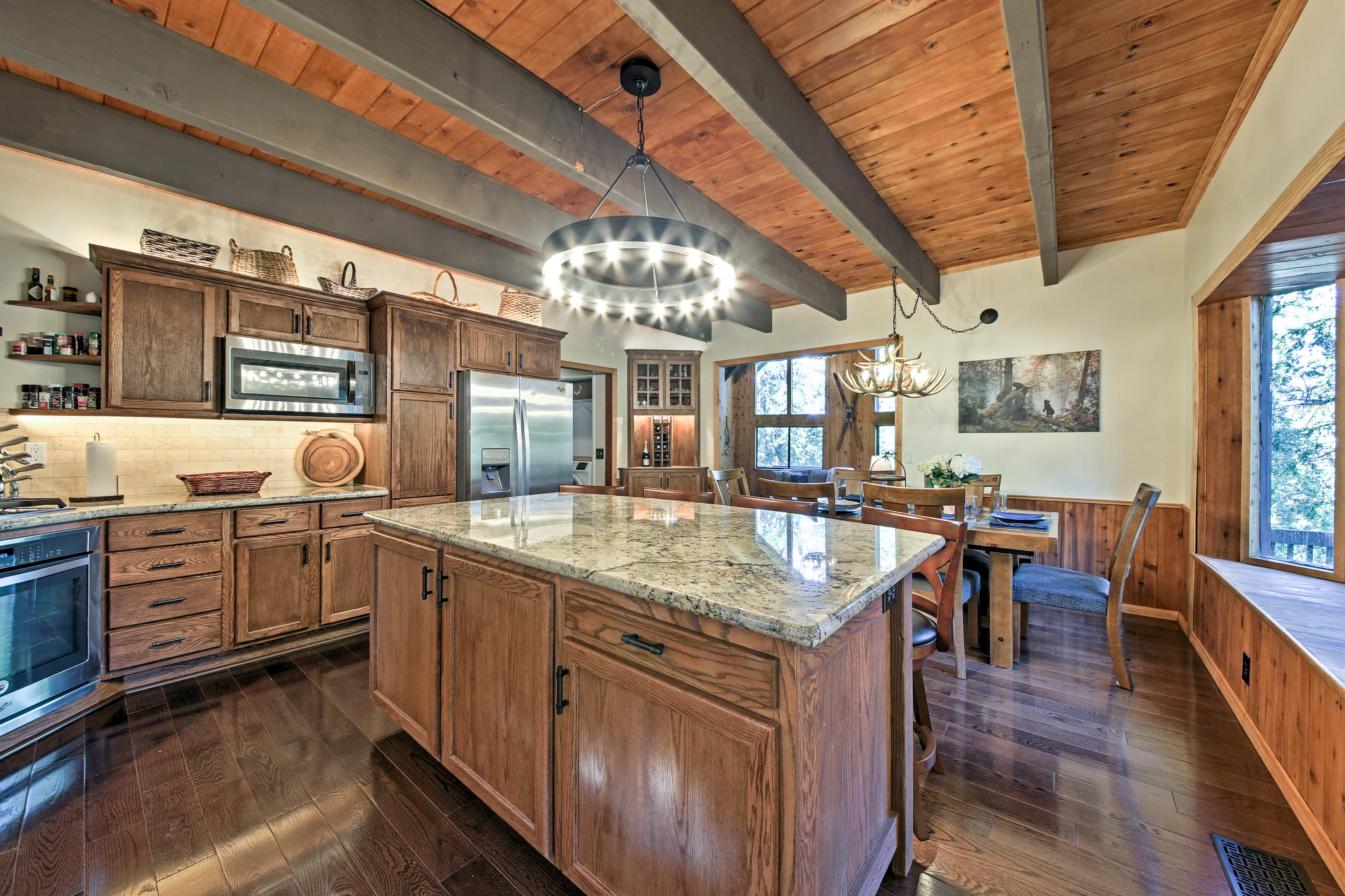 The kitchen features extended counters and a spacious bay window.
