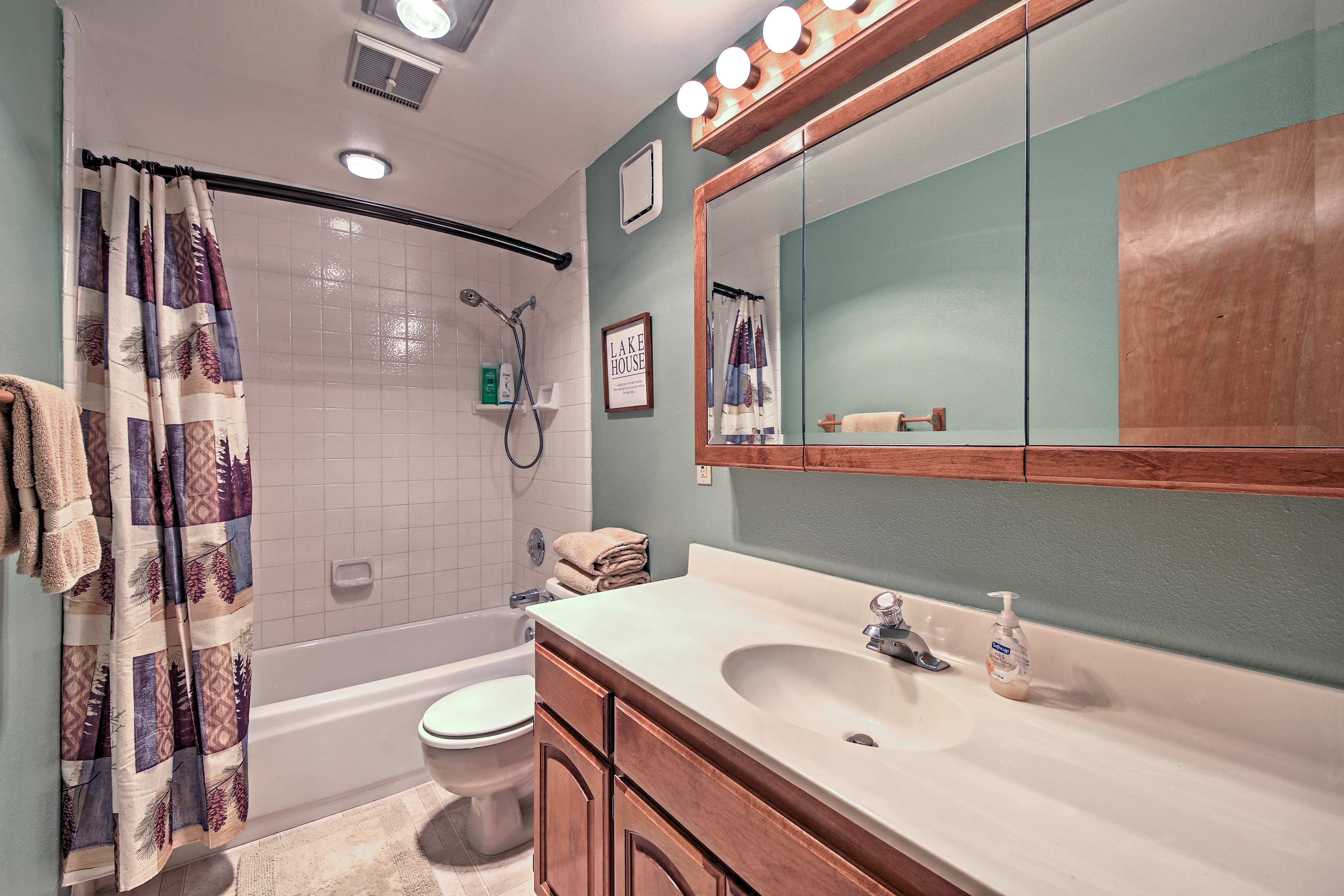 The third full bathroom hosts a shower/tub combo and large vanity.