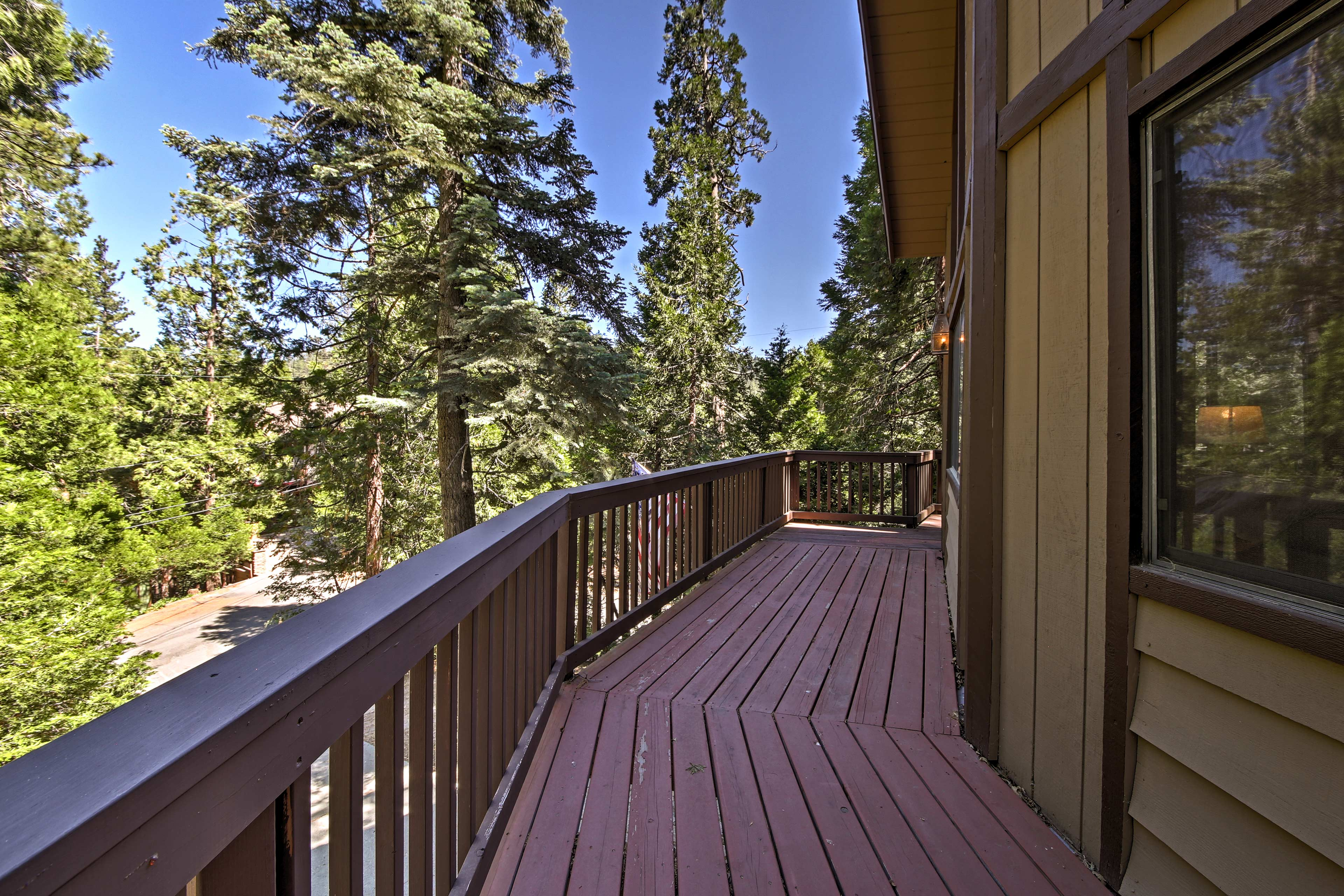 The wraparound deck spans the front of the house.