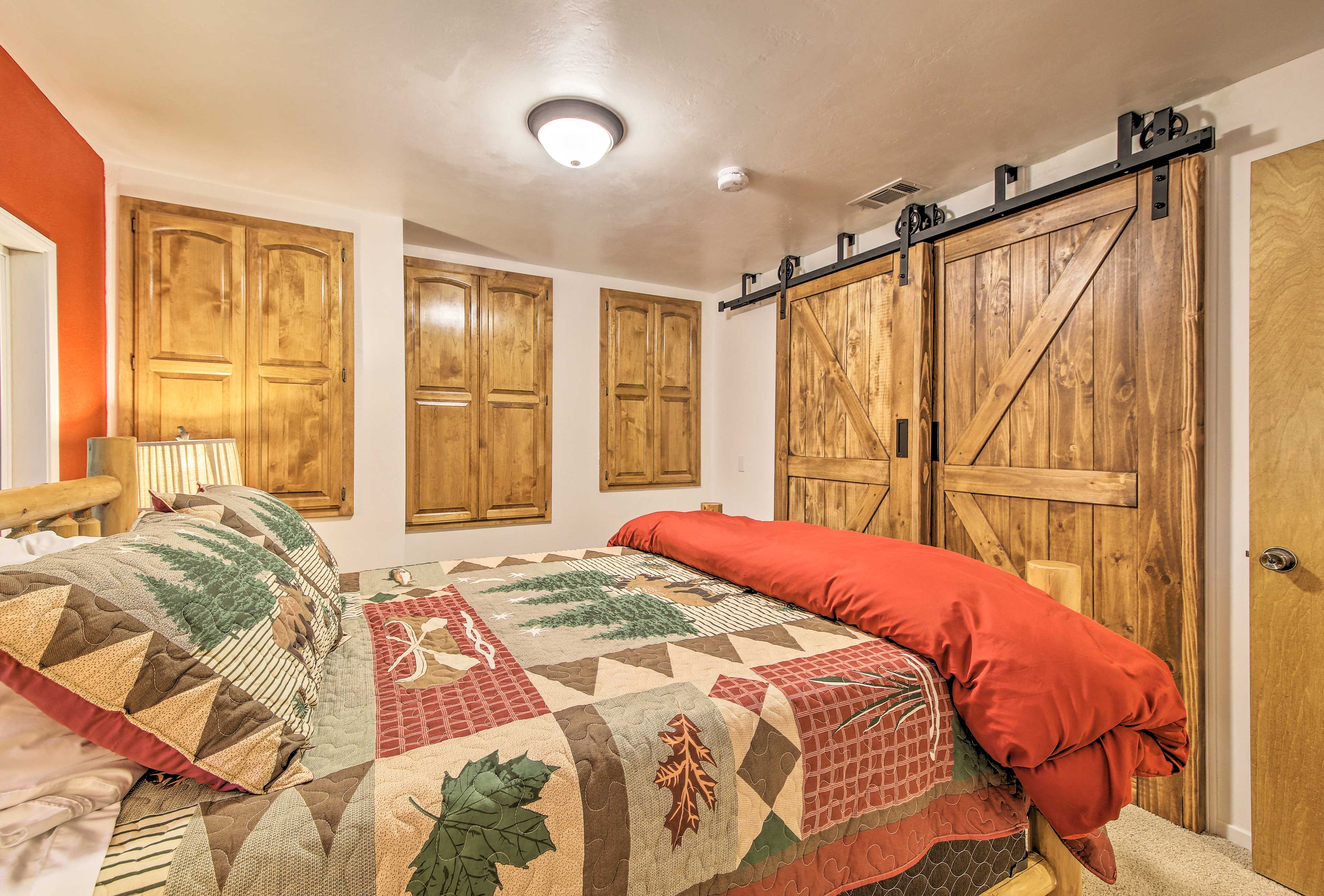 Colorful quilts pair perfectly with rustic wood accents.