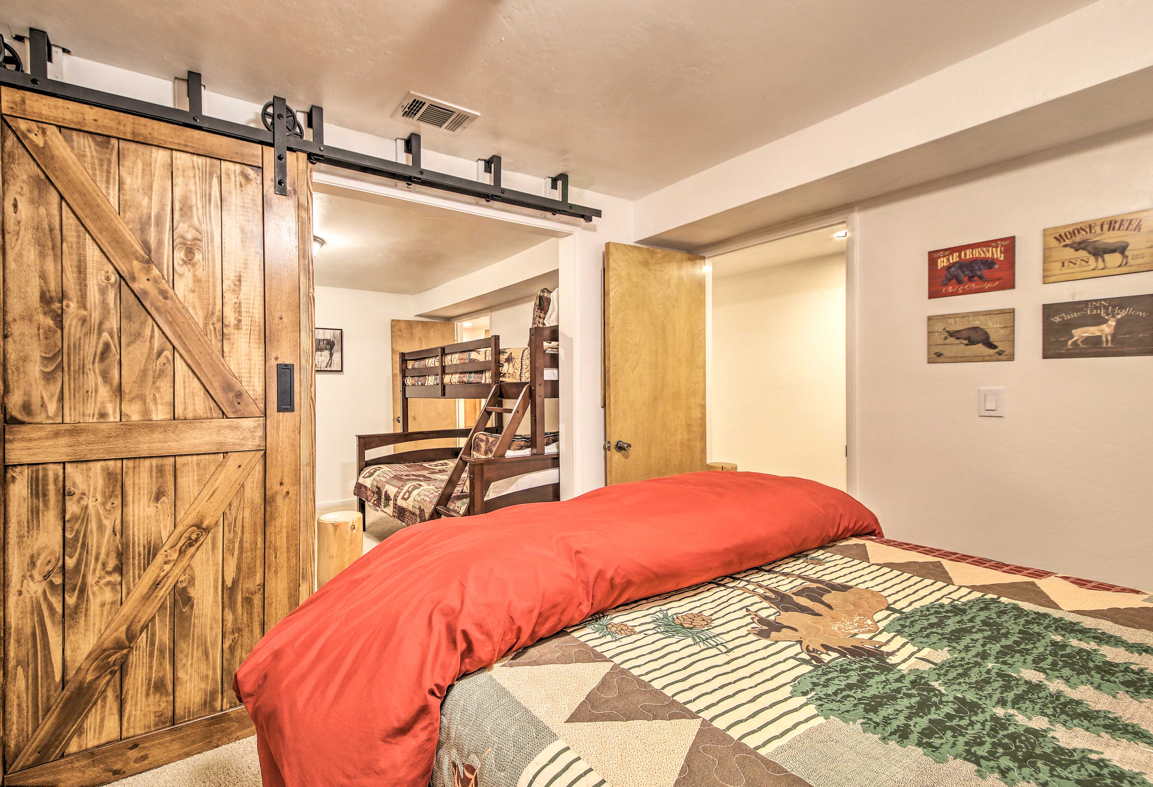 The barn doors slide open to connect this bedroom with the bunk room.