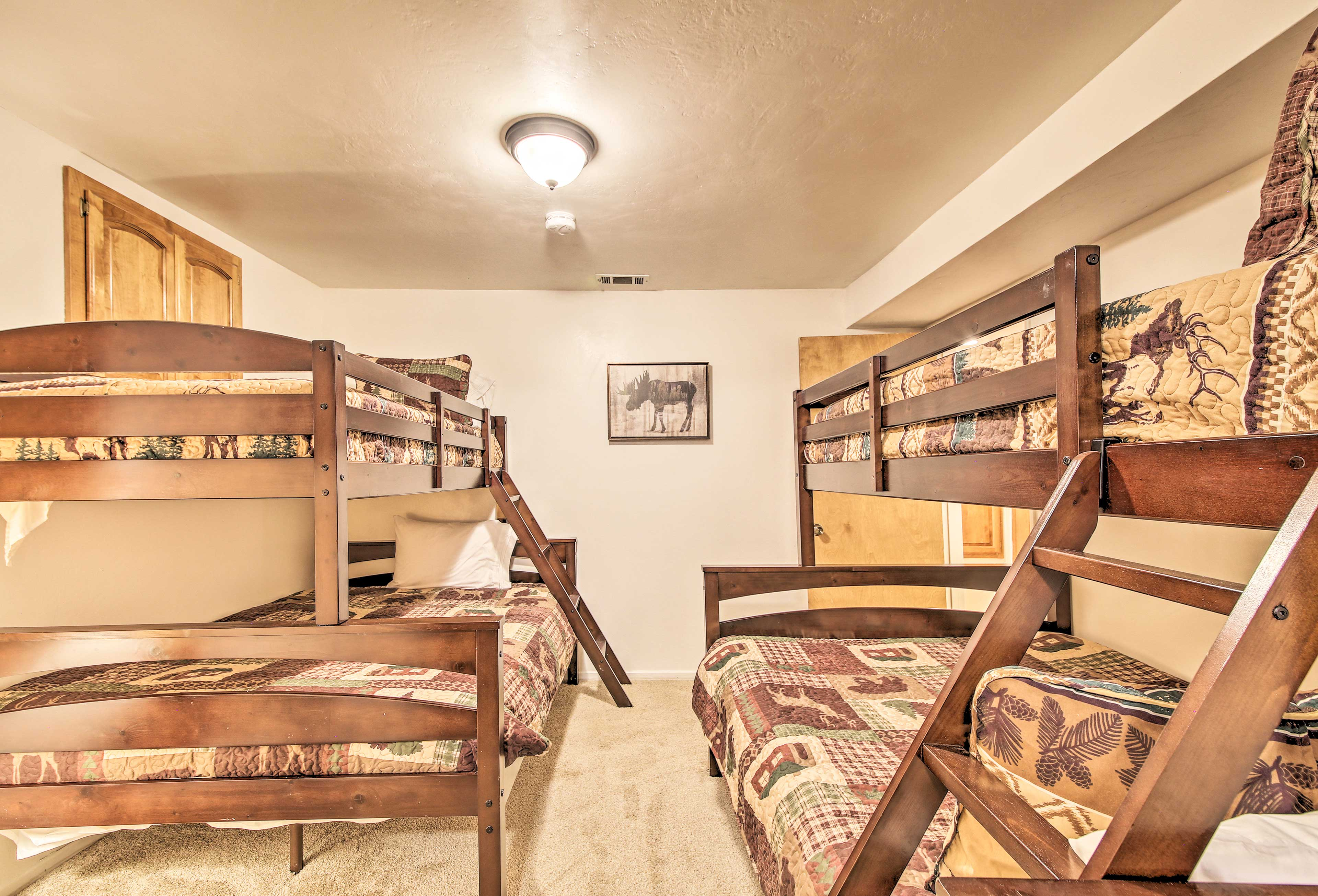This bedroom is furnished with 2 twin-over-full bunk beds.
