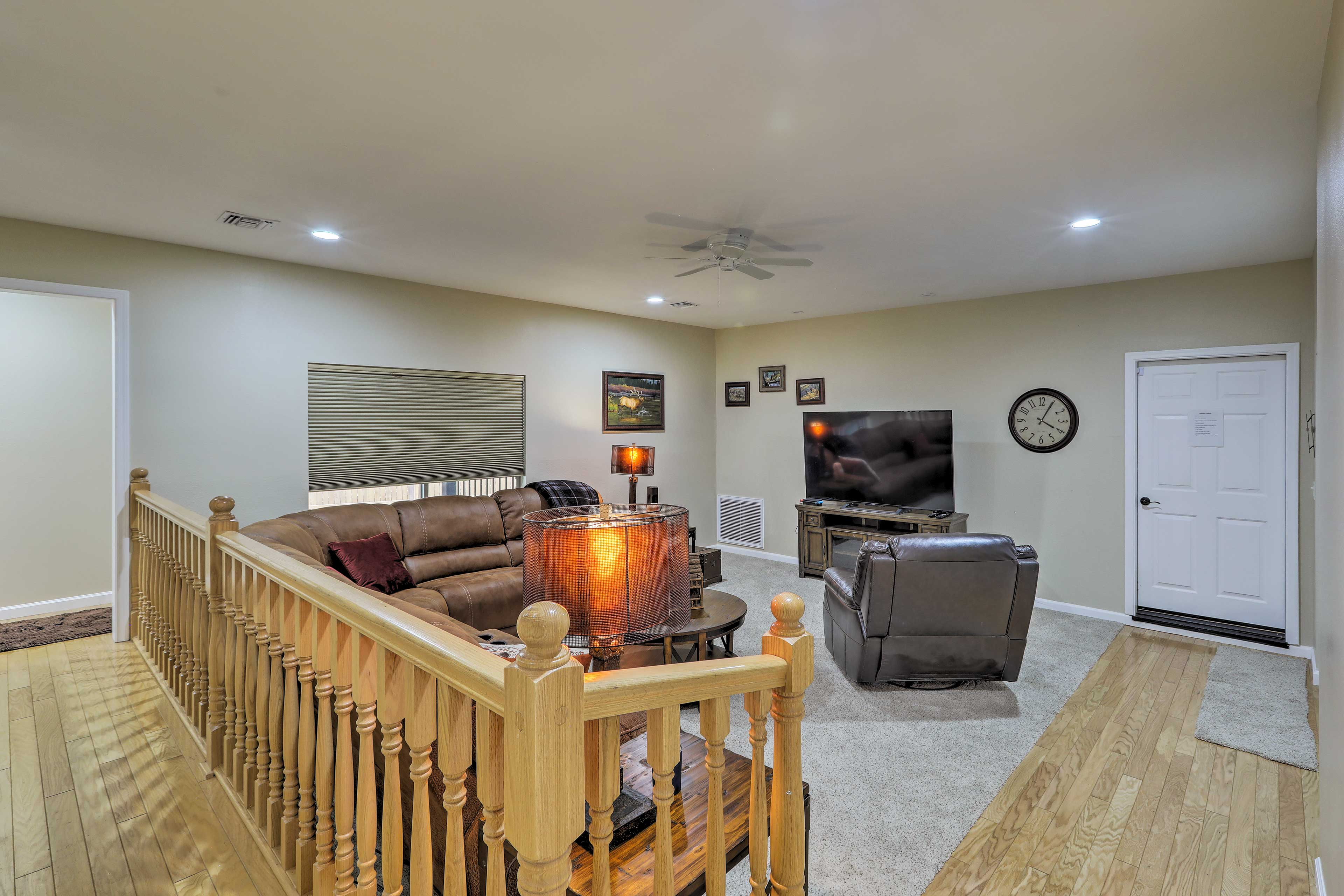 Turn on a new movie using the flat-screen cable TV in this living space.