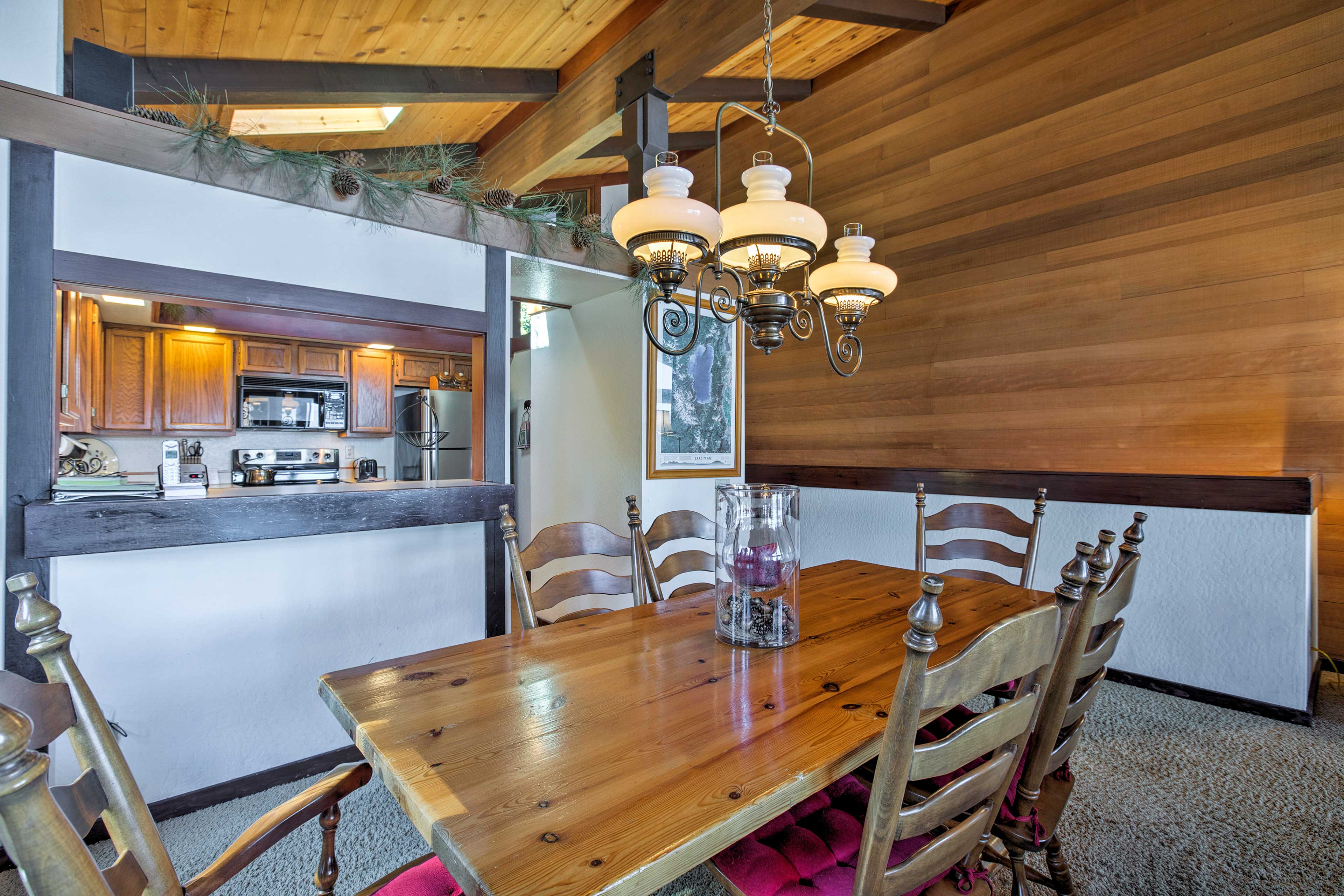 Gather around the wooden dining table for a home-cooked meal.