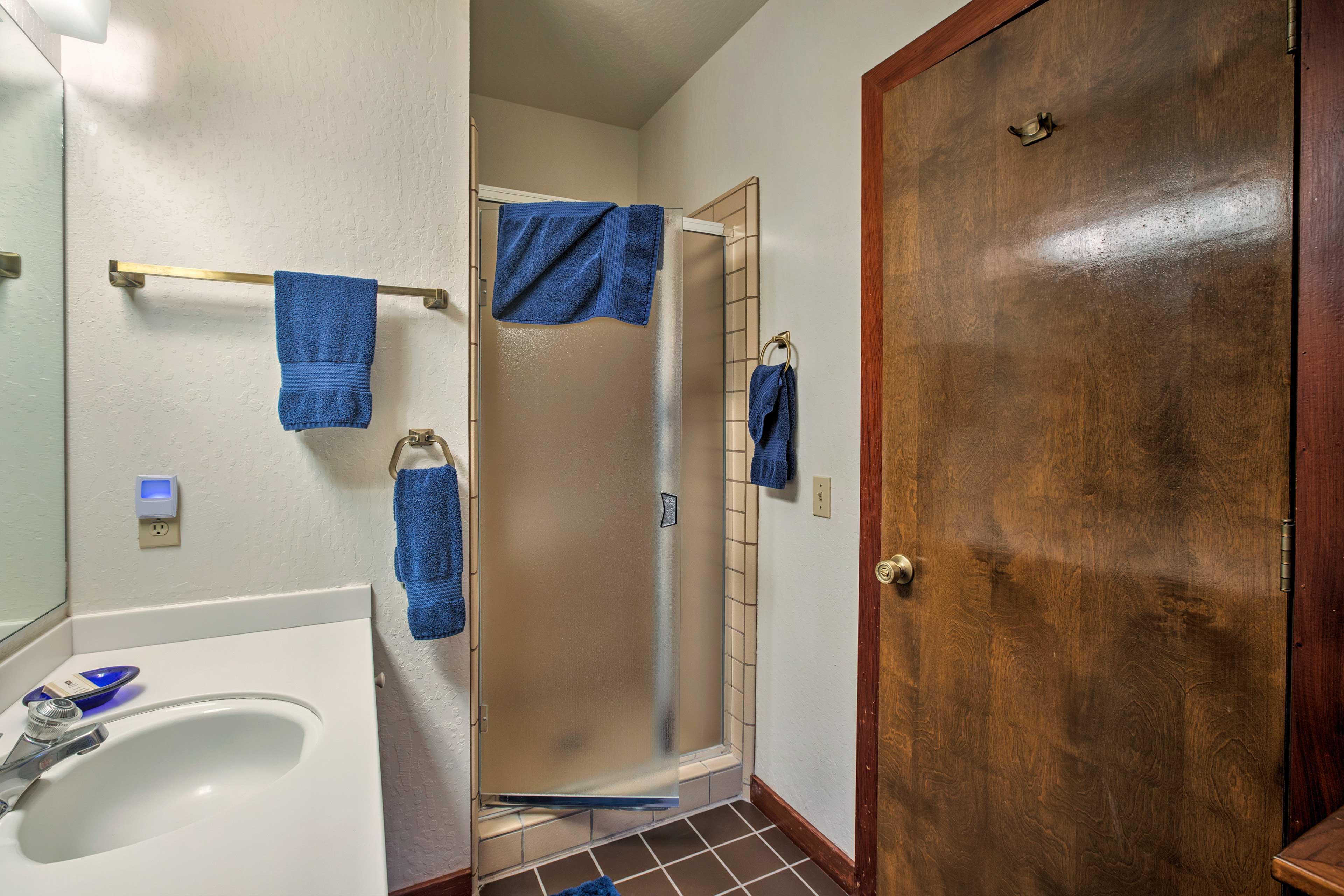 Enjoy a hot shower in this en-suite bath.
