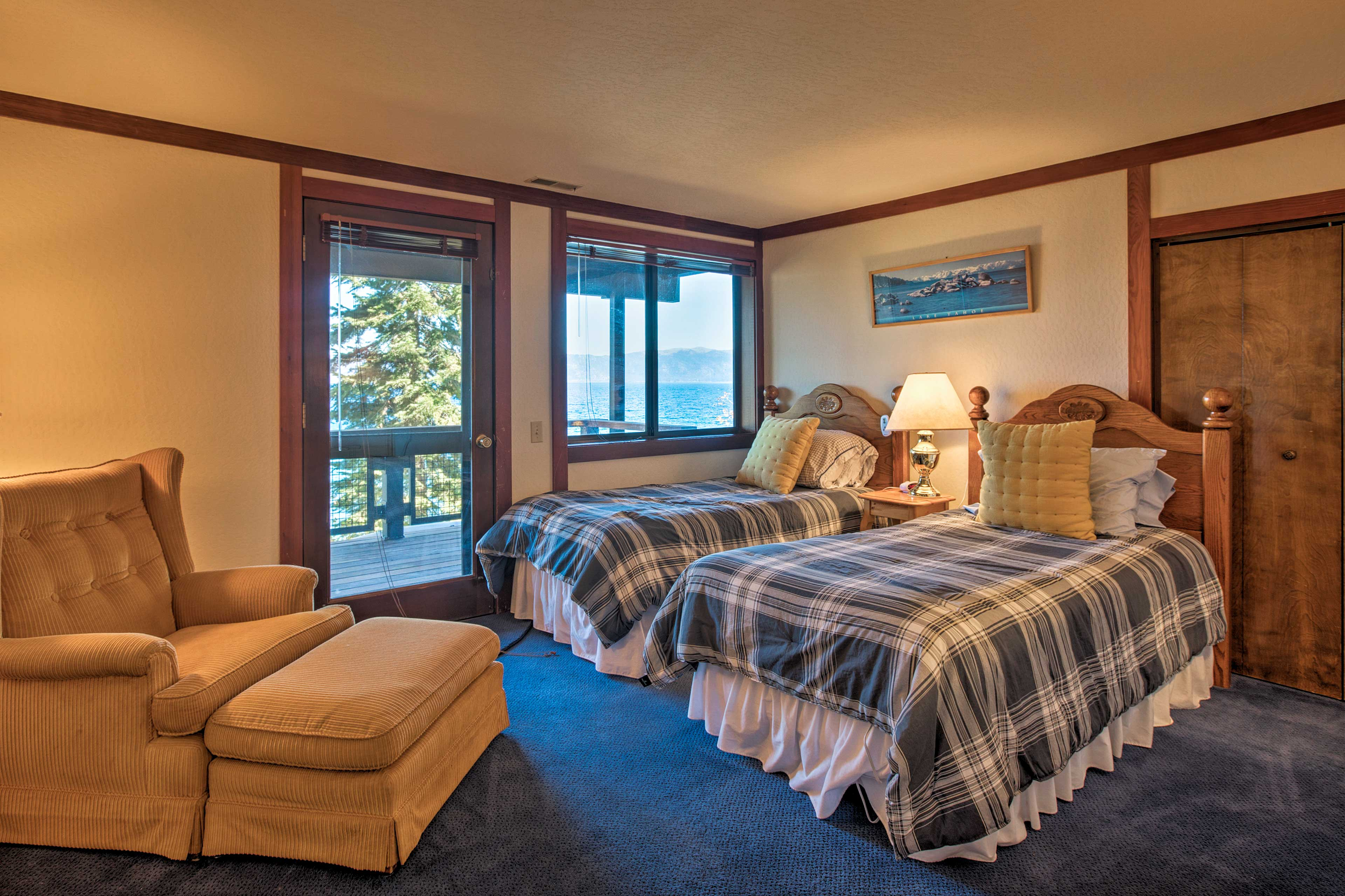 This second master suite features 2 twin beds and a private deck.