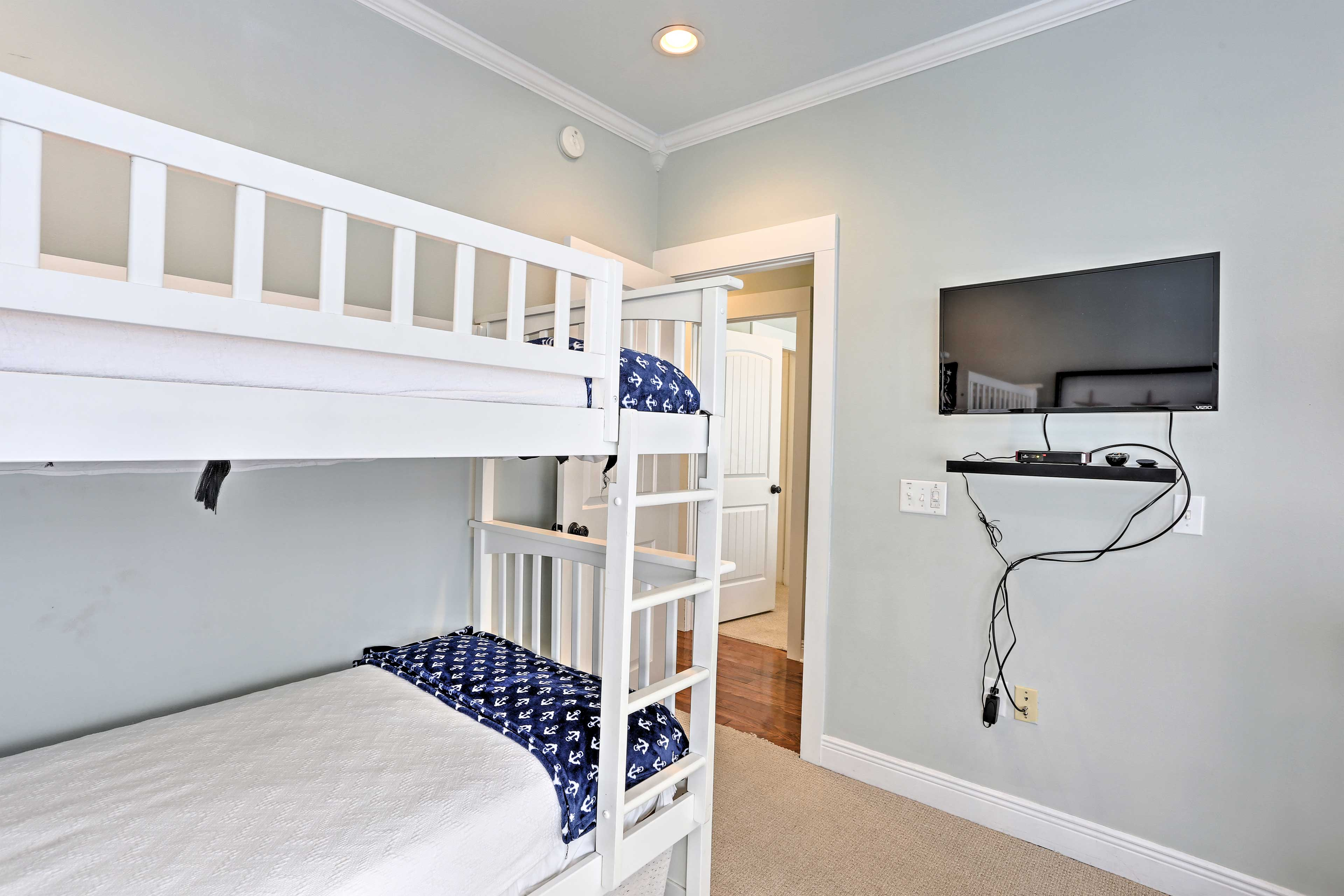 The space features 2 twin-over-twin bunk beds.