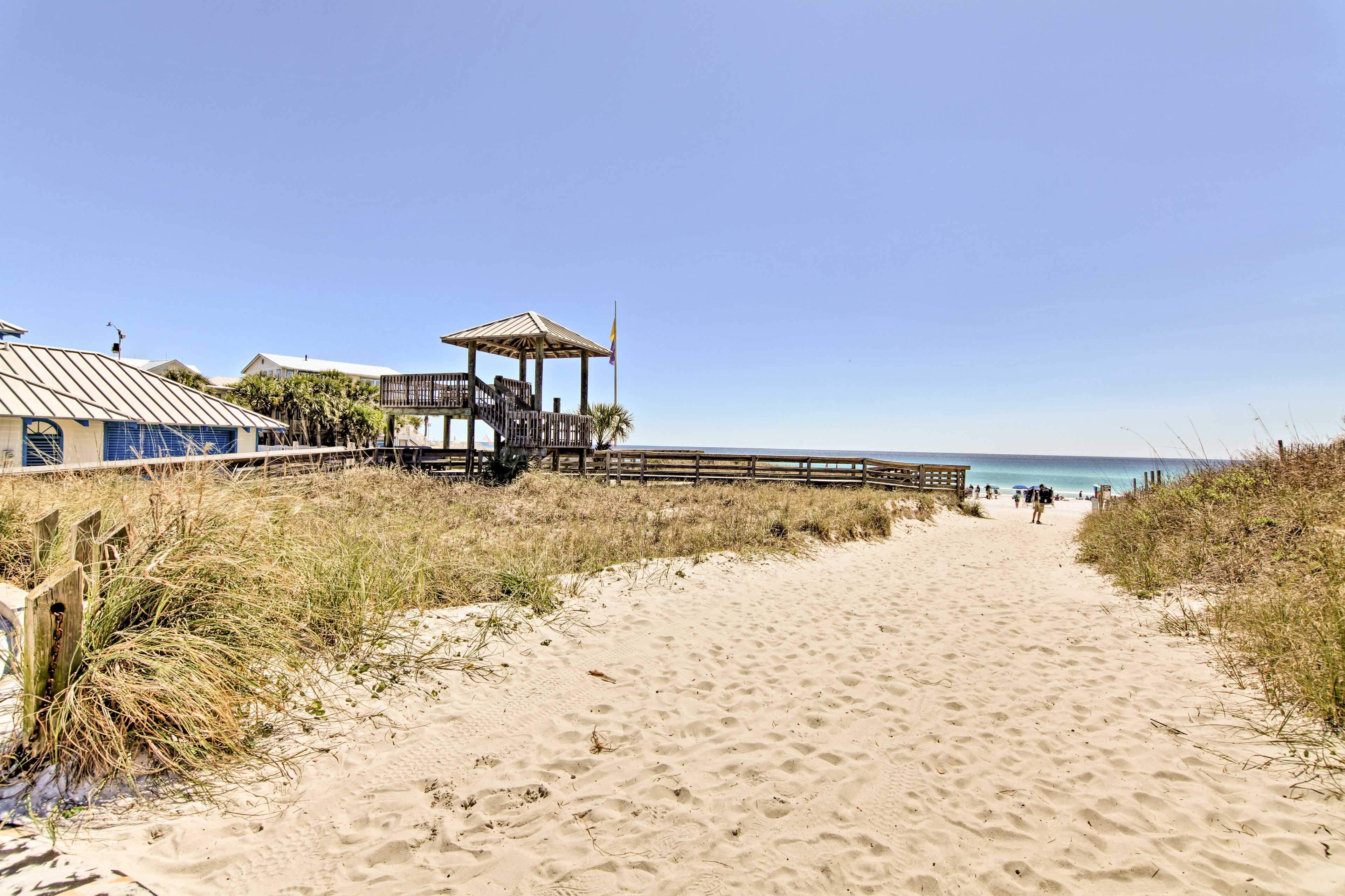 The beach awaits a short walk away!