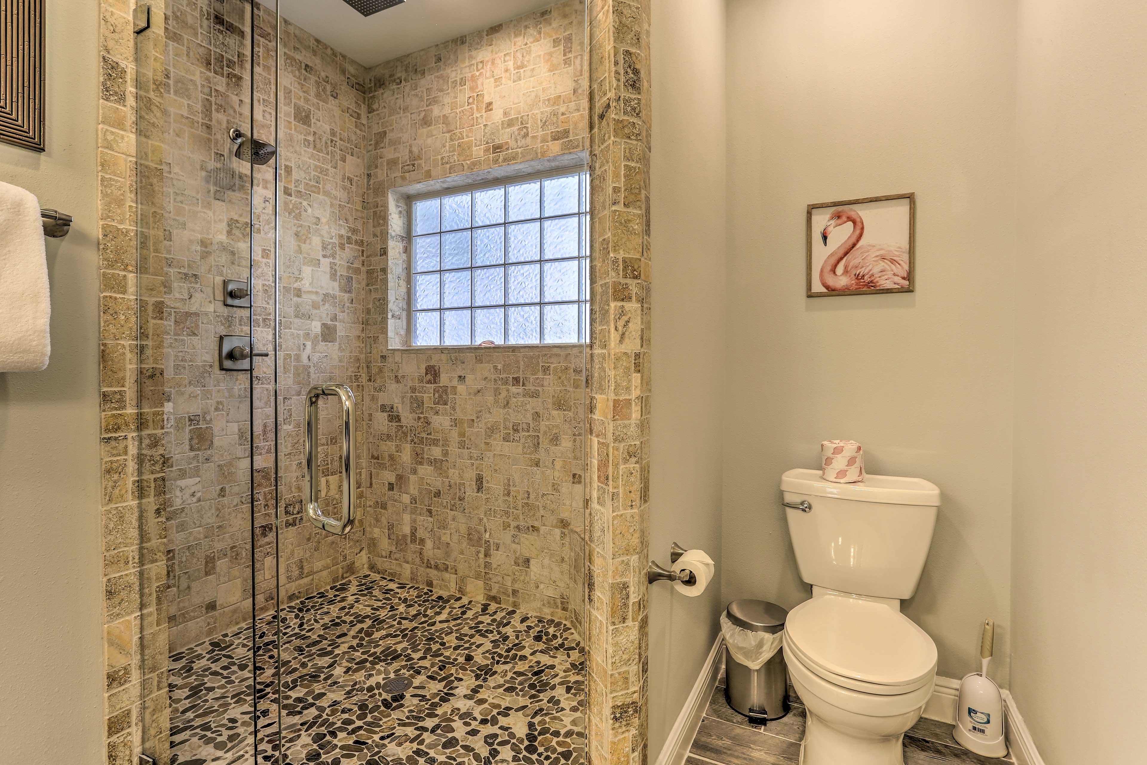 The upscale shower boasts a rain showerhead.
