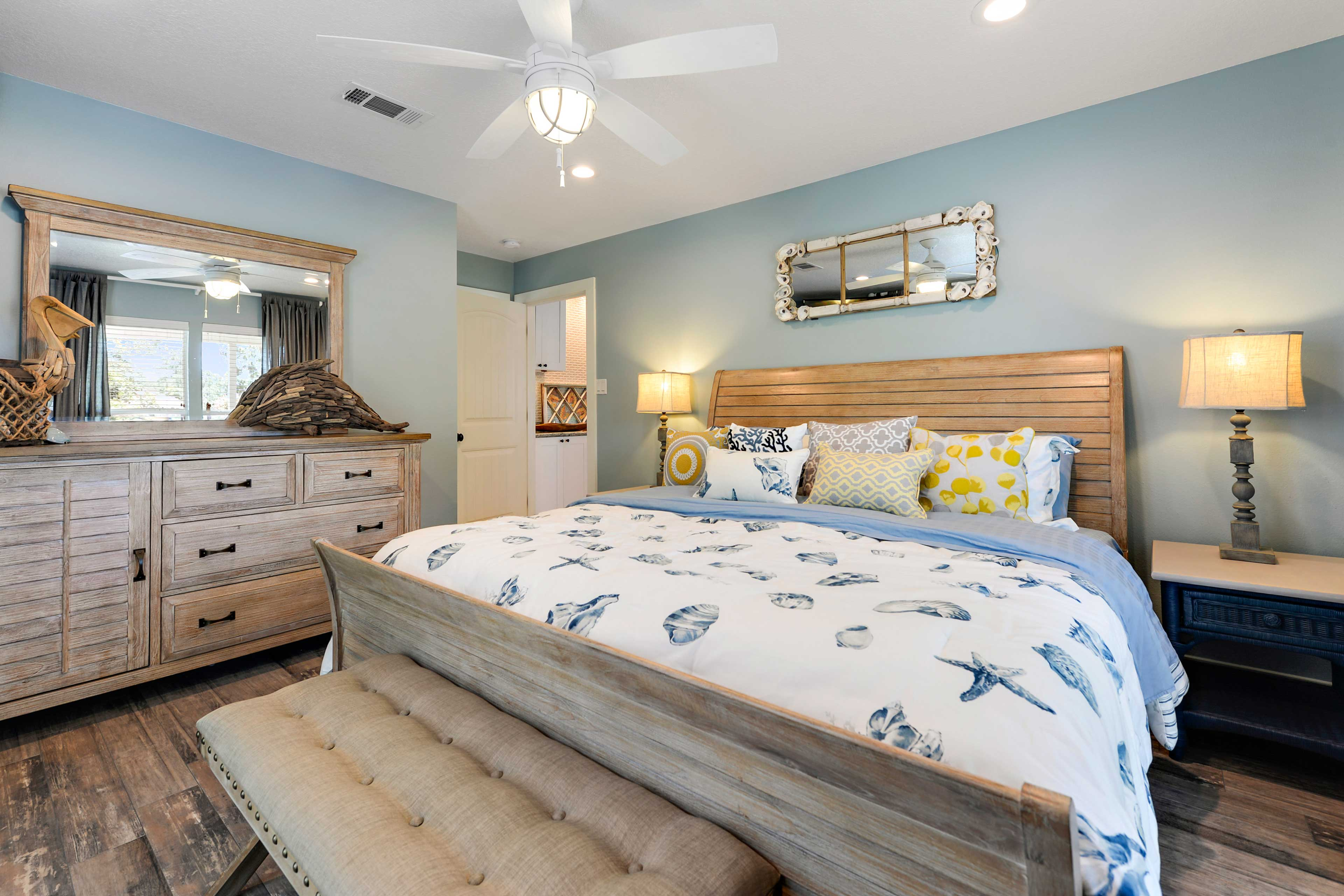 The master bedroom boasts a plus king bed and en-suite bathroom.
