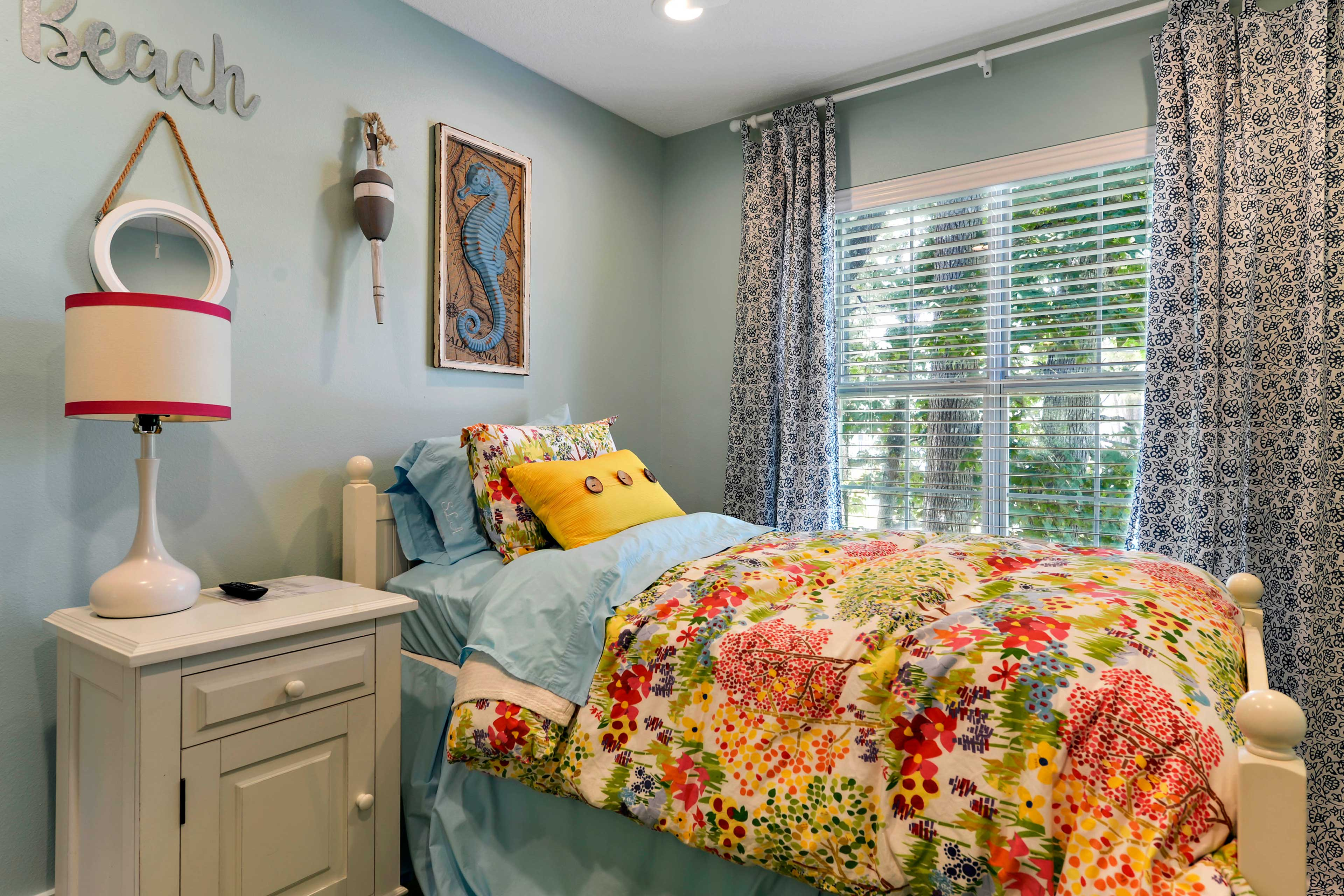You'll love this colorful bedroom with a full bed and full trundle bed.