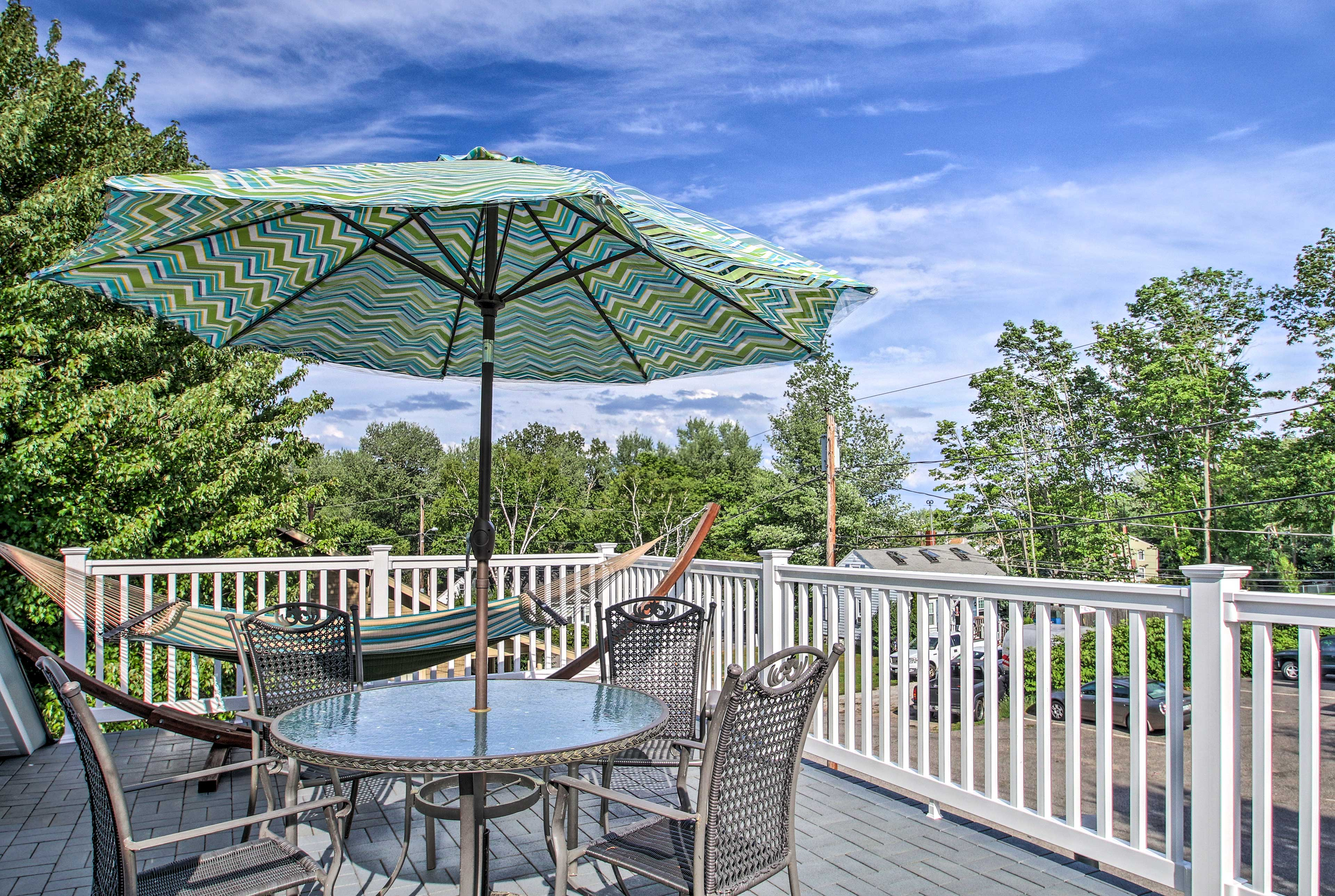 The home has 5 bedrooms, 2 bathrooms, and a rooftop deck!