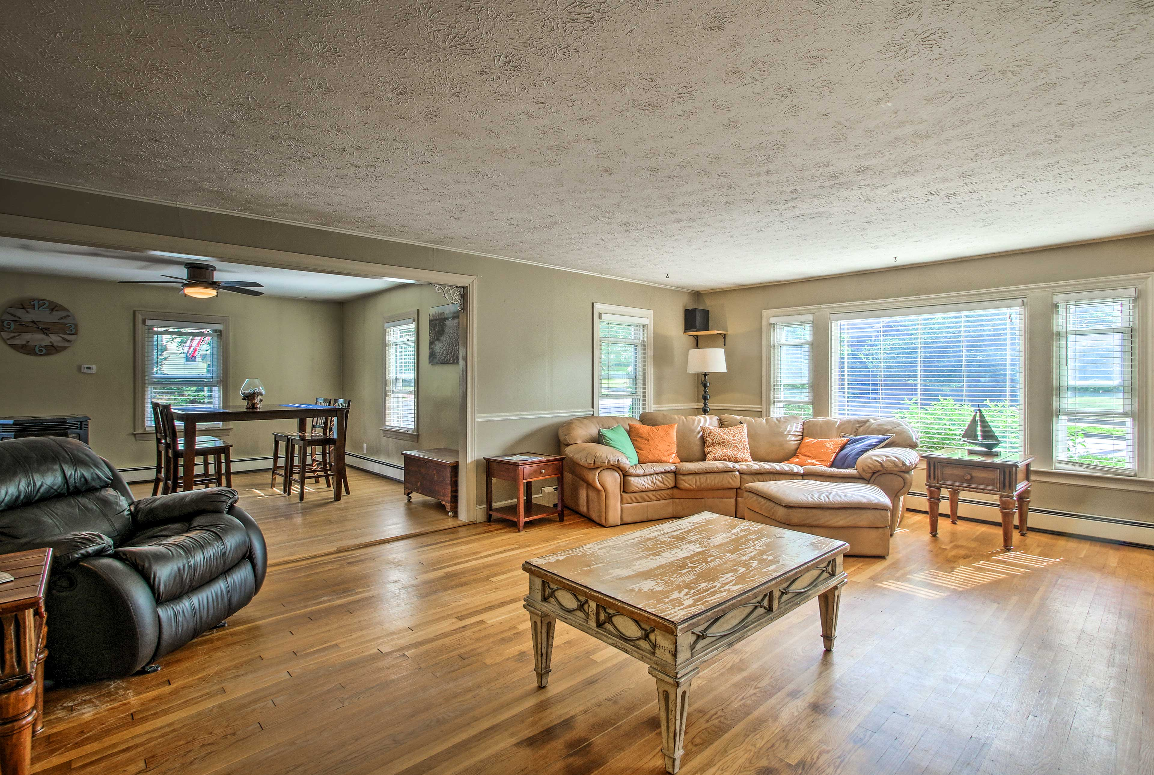 You're greeted with a spacious living room filled with cozy furnishings.