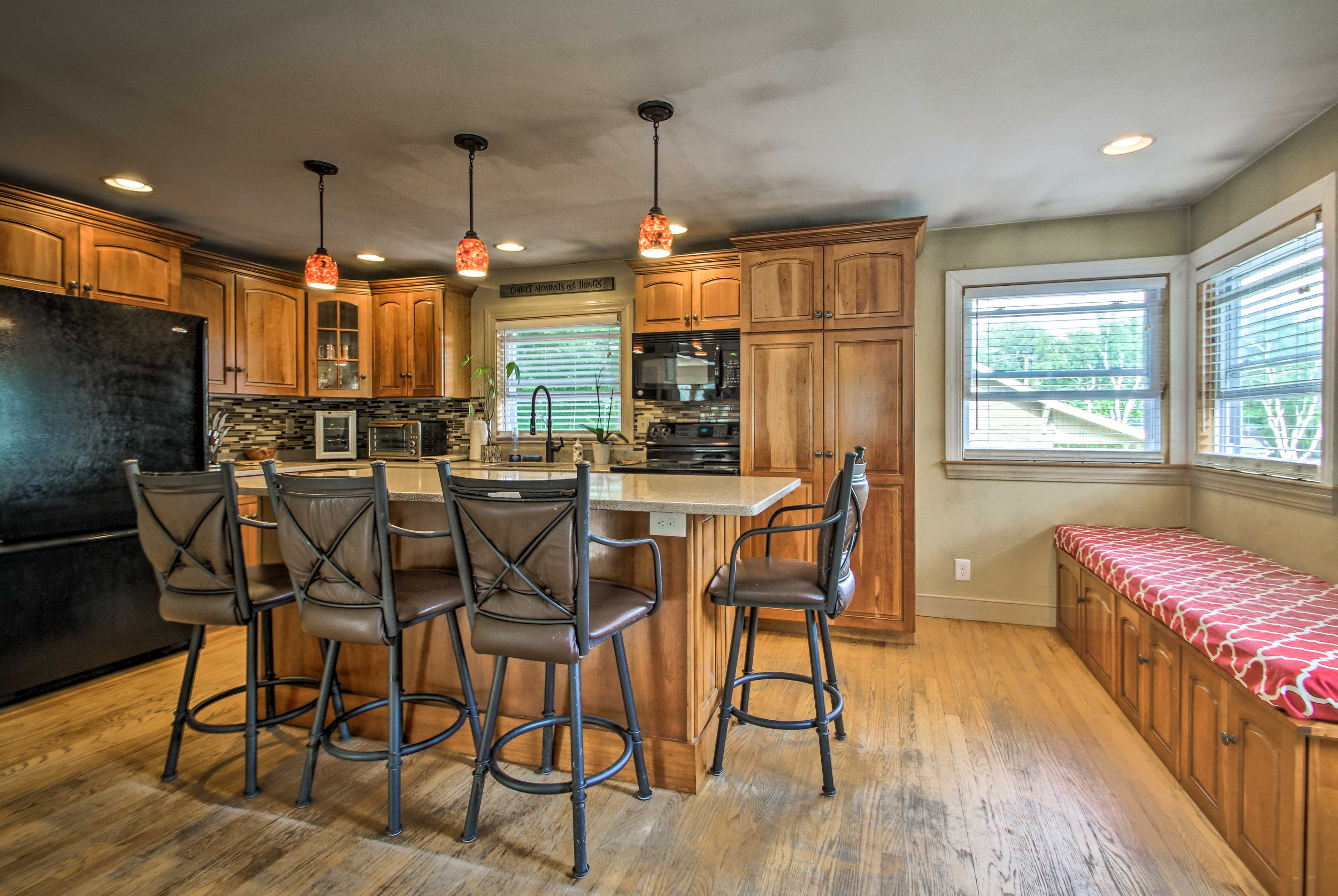 Step into the kitchen to find a large center island with bar stool seating.